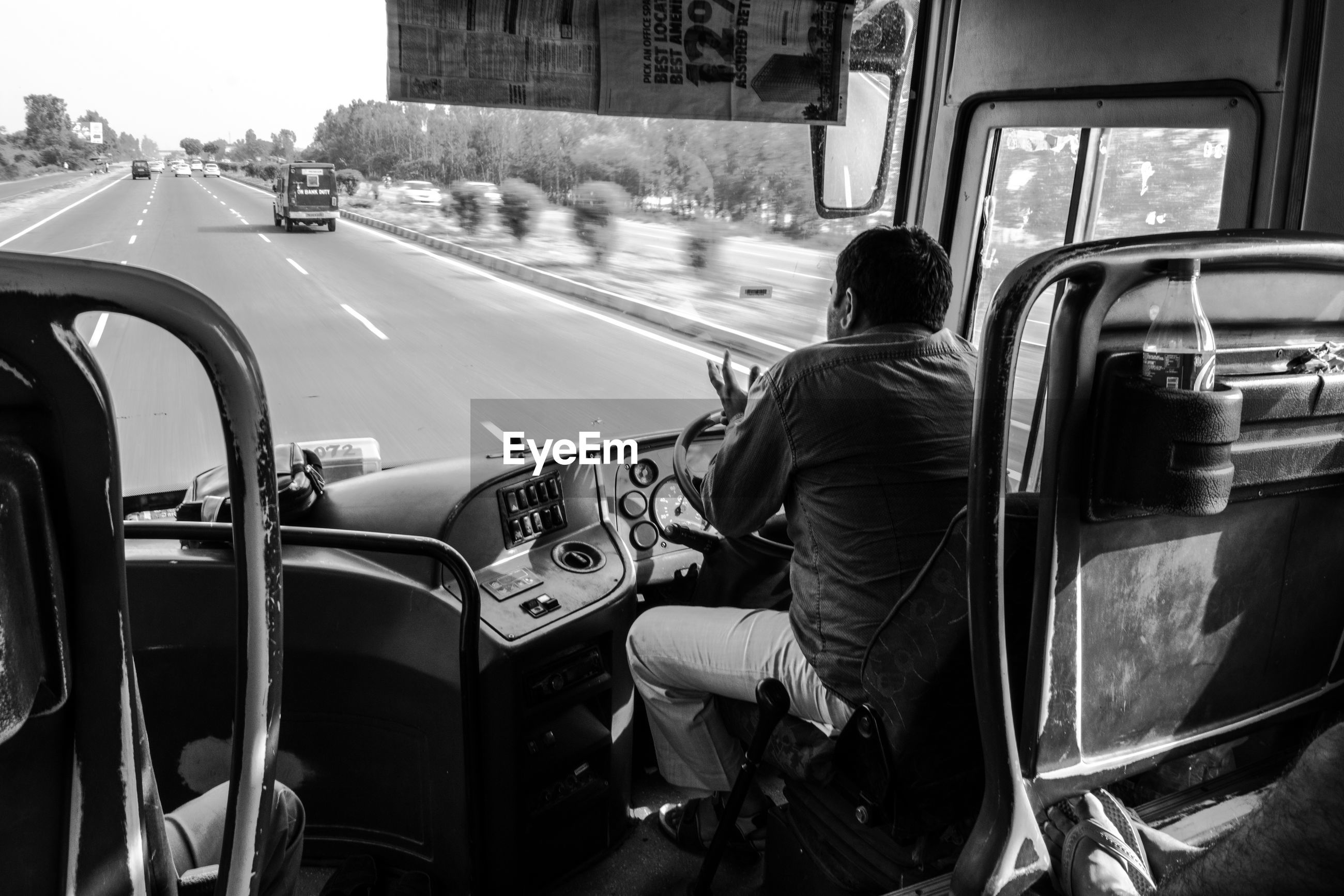 real people, transportation, car, land vehicle, one person, rear view, mode of transport, men, road, day, street, outdoors, lifestyles, motorcycle, city, full length, sitting, architecture, people