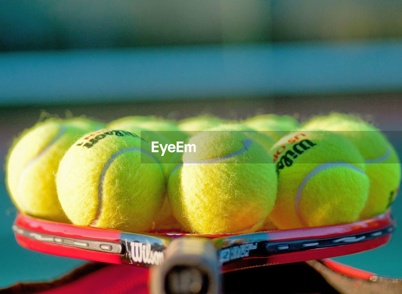 sport, ball, tennis, tennis ball, close-up, wellbeing, healthy eating, freshness, no people, food, fruit, food and drink, day, group of objects, still life, sports equipment, court, selective focus, green color, focus on foreground