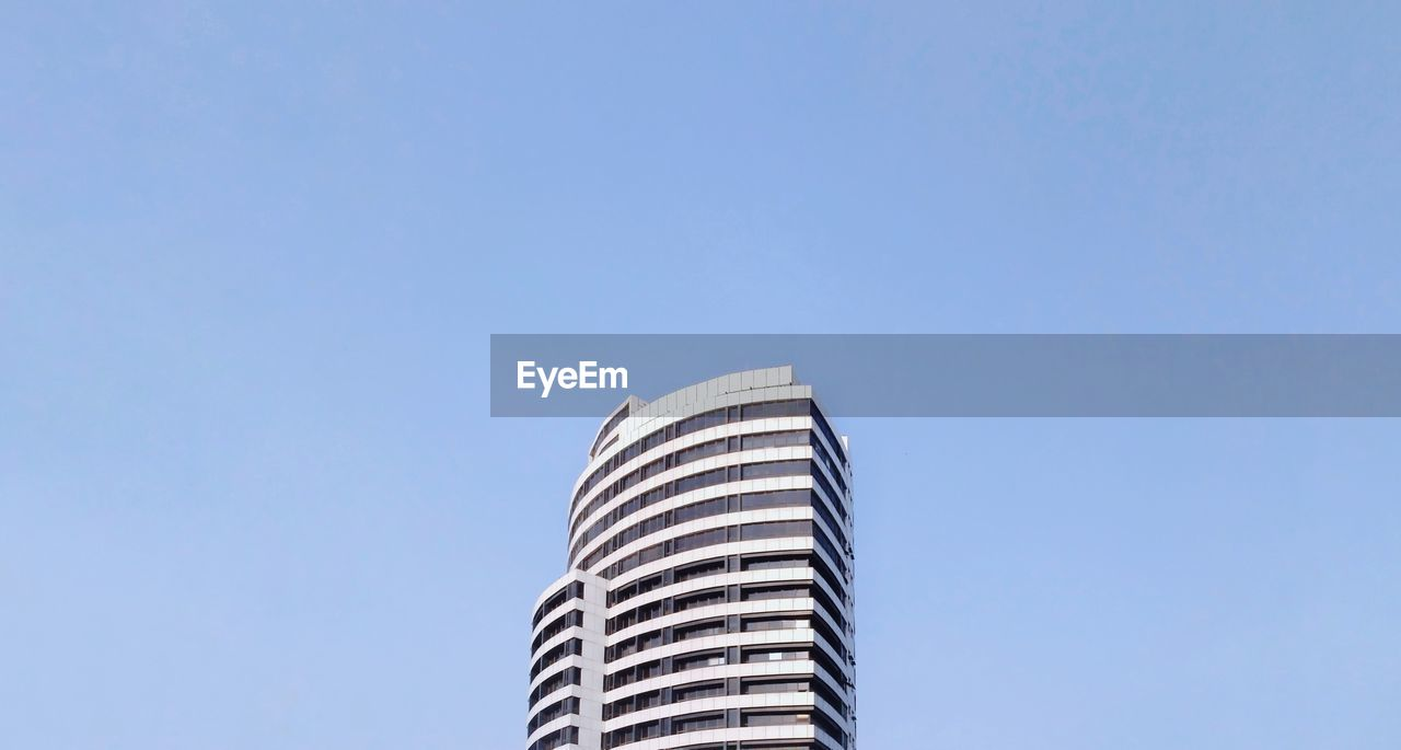 sky, built structure, building exterior, architecture, copy space, low angle view, building, clear sky, office building exterior, city, nature, blue, no people, day, skyscraper, tower, tall - high, outdoors, office, development