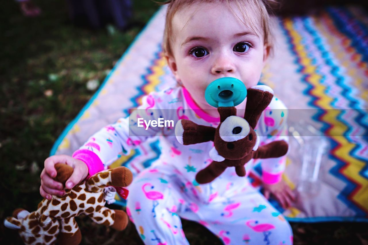 childhood, child, real people, portrait, looking at camera, front view, one person, innocence, cute, baby, toy, leisure activity, holding, females, focus on foreground, babyhood, lifestyles, young
