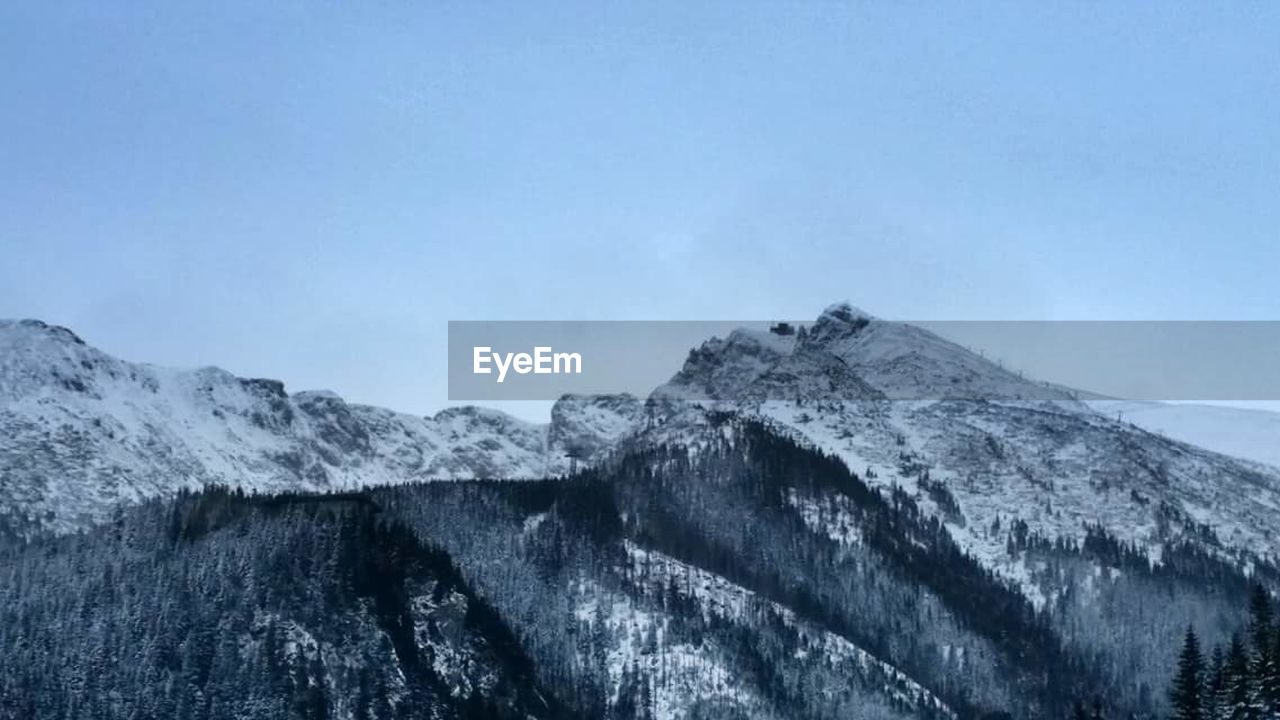 snow, cold temperature, winter, mountain, nature, no people, weather, day, beauty in nature, outdoors, scenics, tranquility, frozen, blue, sky, mountain range, clear sky
