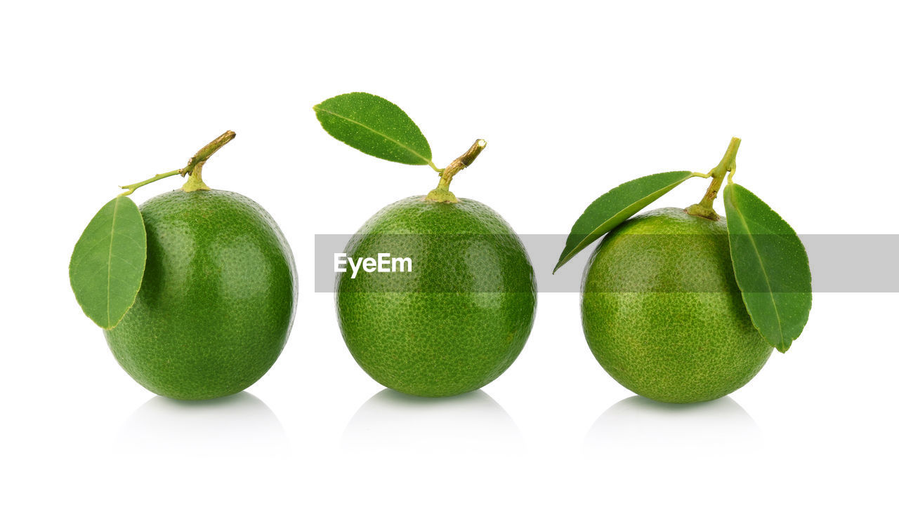 white background, studio shot, green color, healthy eating, food and drink, fruit, food, cut out, indoors, freshness, still life, wellbeing, group of objects, close-up, leaf, plant part, no people, plant stem, citrus fruit, three objects