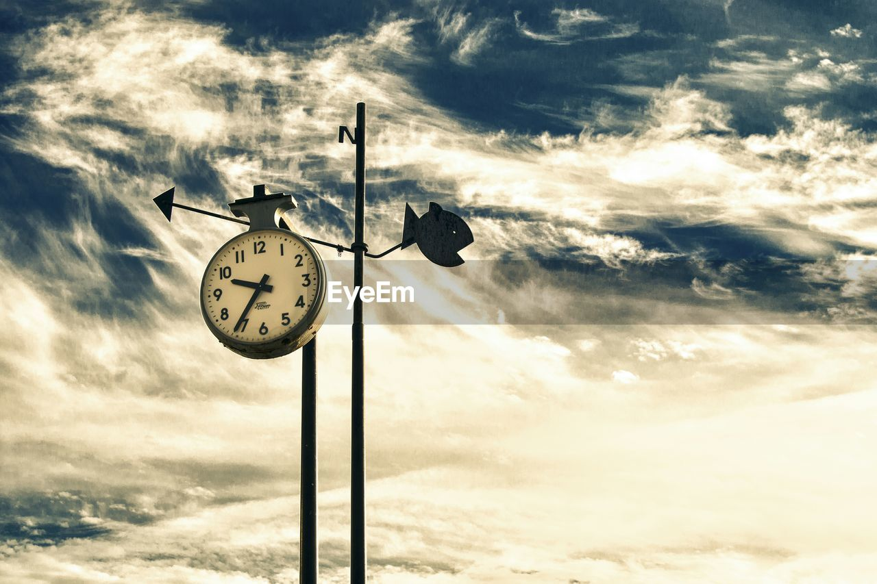 cloud - sky, sky, time, clock, no people, nature, low angle view, bird, outdoors, weather vane, day, sunset, beauty in nature, sea, animal themes, perching, minute hand