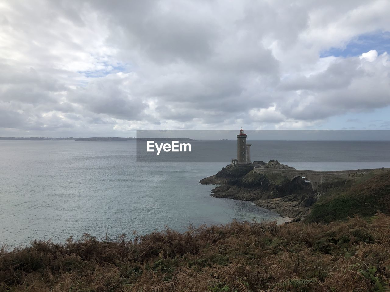sea, sky, cloud - sky, water, guidance, tower, scenics - nature, horizon, beauty in nature, horizon over water, built structure, architecture, lighthouse, direction, tranquil scene, tranquility, land, building exterior, building, no people, outdoors