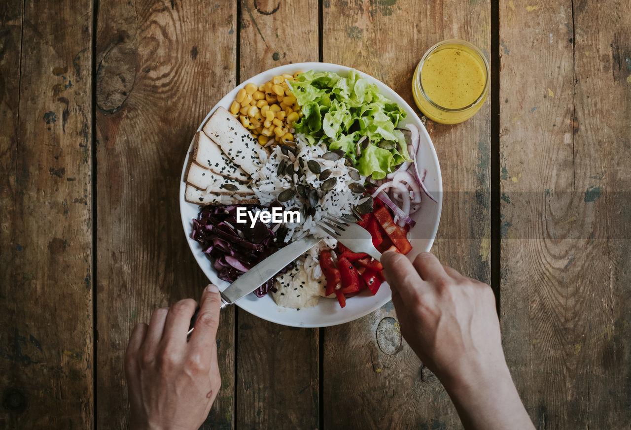 food, human hand, food and drink, freshness, hand, holding, human body part, table, wellbeing, one person, directly above, high angle view, fruit, healthy eating, kitchen utensil, lifestyles, real people, eating utensil, bowl, indoors, meal, finger