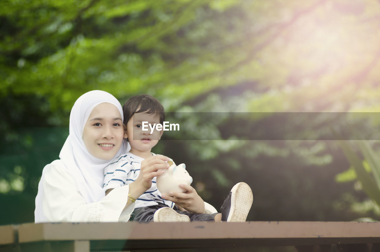 family, child, togetherness, childhood, women, females, bonding, males, boys, portrait, parent, mother, men, emotion, real people, family with one child, looking at camera, adult, innocence, positive emotion, son, daughter, sister, outdoors