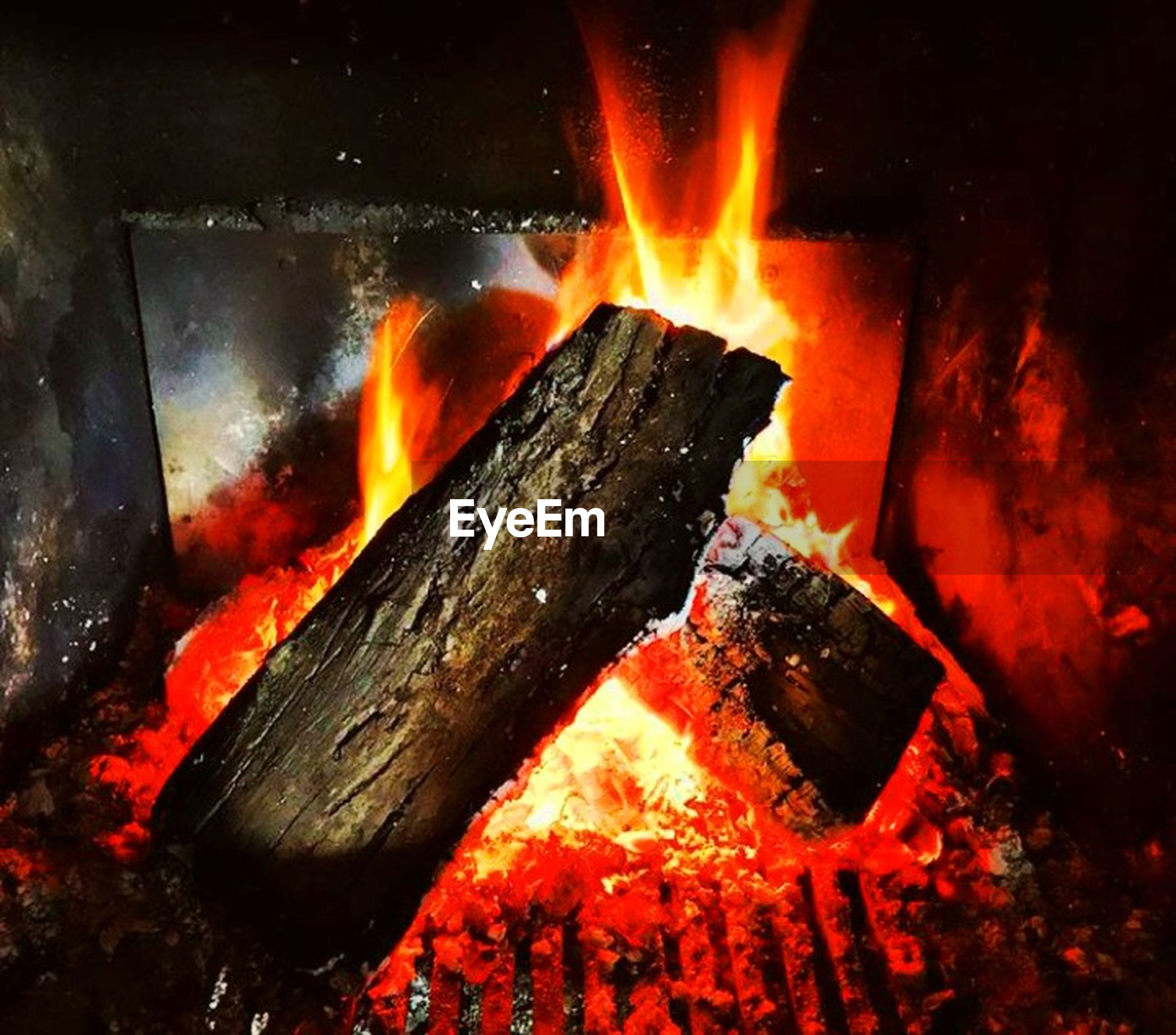 burning, heat - temperature, fire, fire - natural phenomenon, flame, wood - material, log, firewood, wood, glowing, nature, no people, orange color, close-up, outdoors, bonfire, motion, high angle view, night, burnt