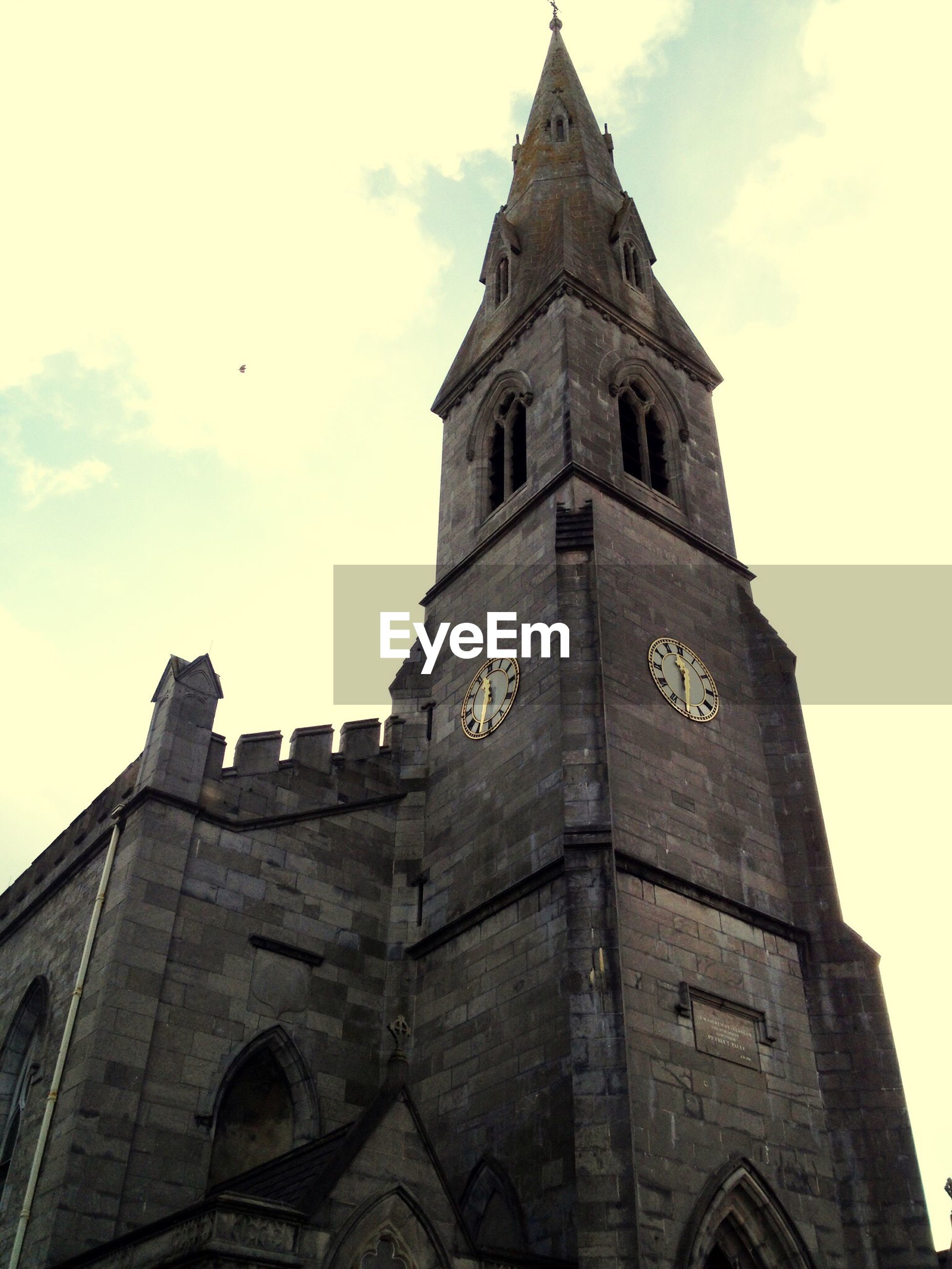 architecture, tower, low angle view, religion, clock tower, history, sky, building exterior, place of worship, spirituality, built structure, outdoors, no people, travel destinations, day, clock, bell tower