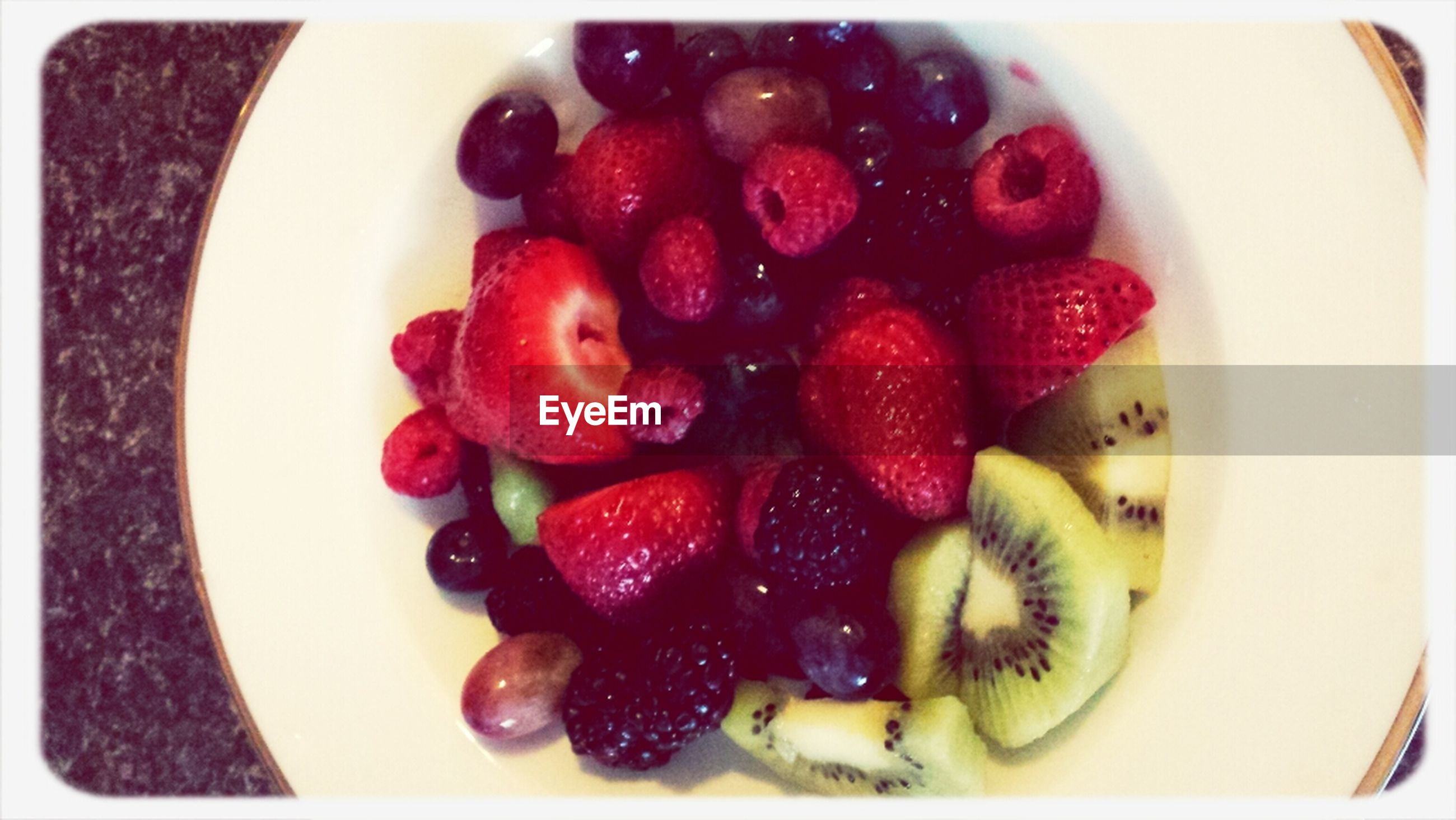 food and drink, food, freshness, fruit, indoors, healthy eating, strawberry, sweet food, transfer print, plate, ready-to-eat, still life, berry fruit, close-up, raspberry, high angle view, dessert, bowl, red, indulgence