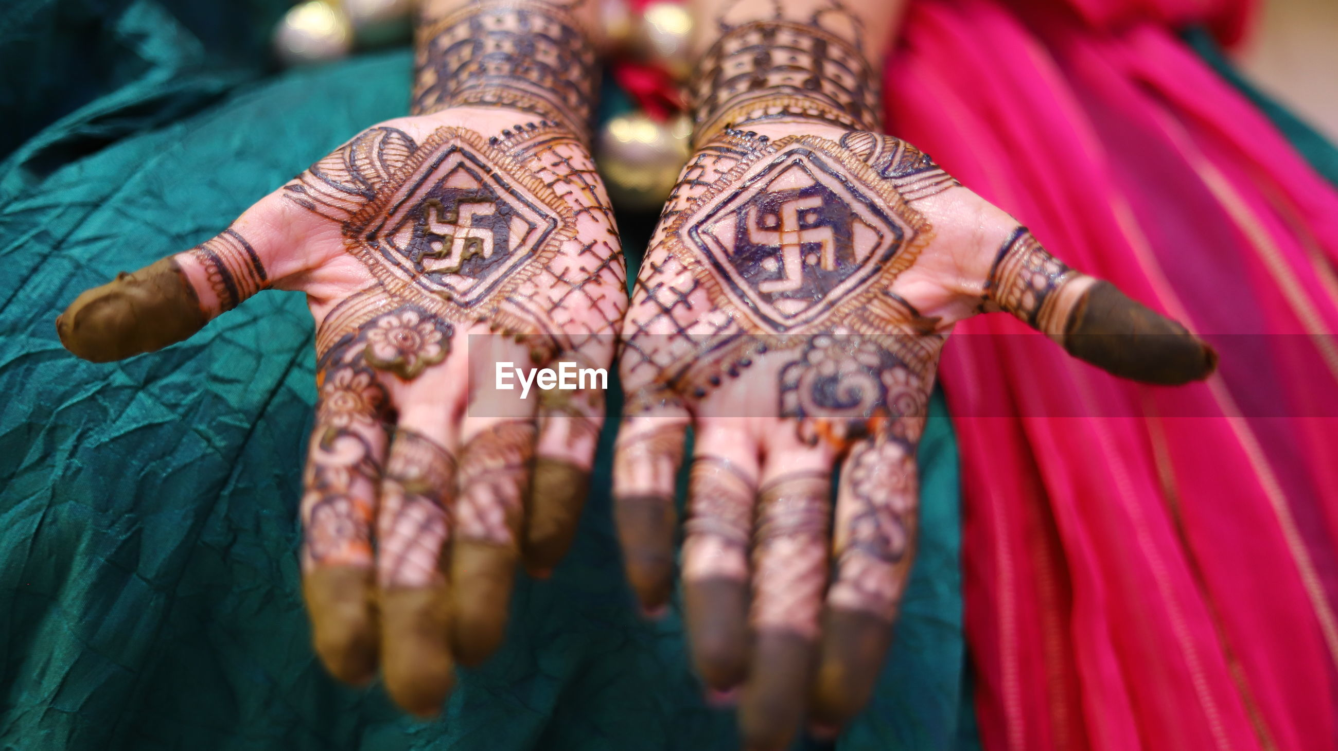 Close-up of woman hand with henna tattoo