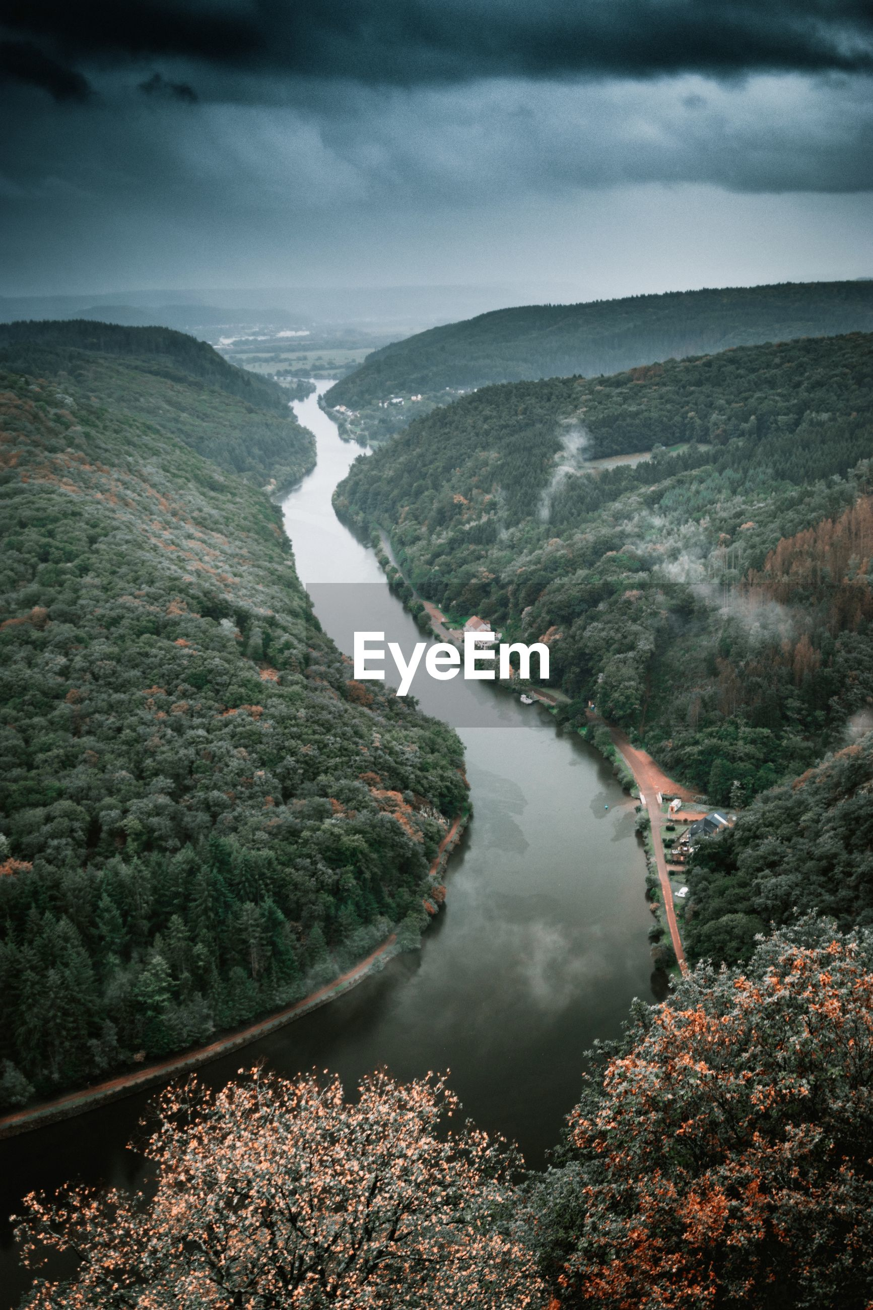 High angle view of river amidst landscape against sky