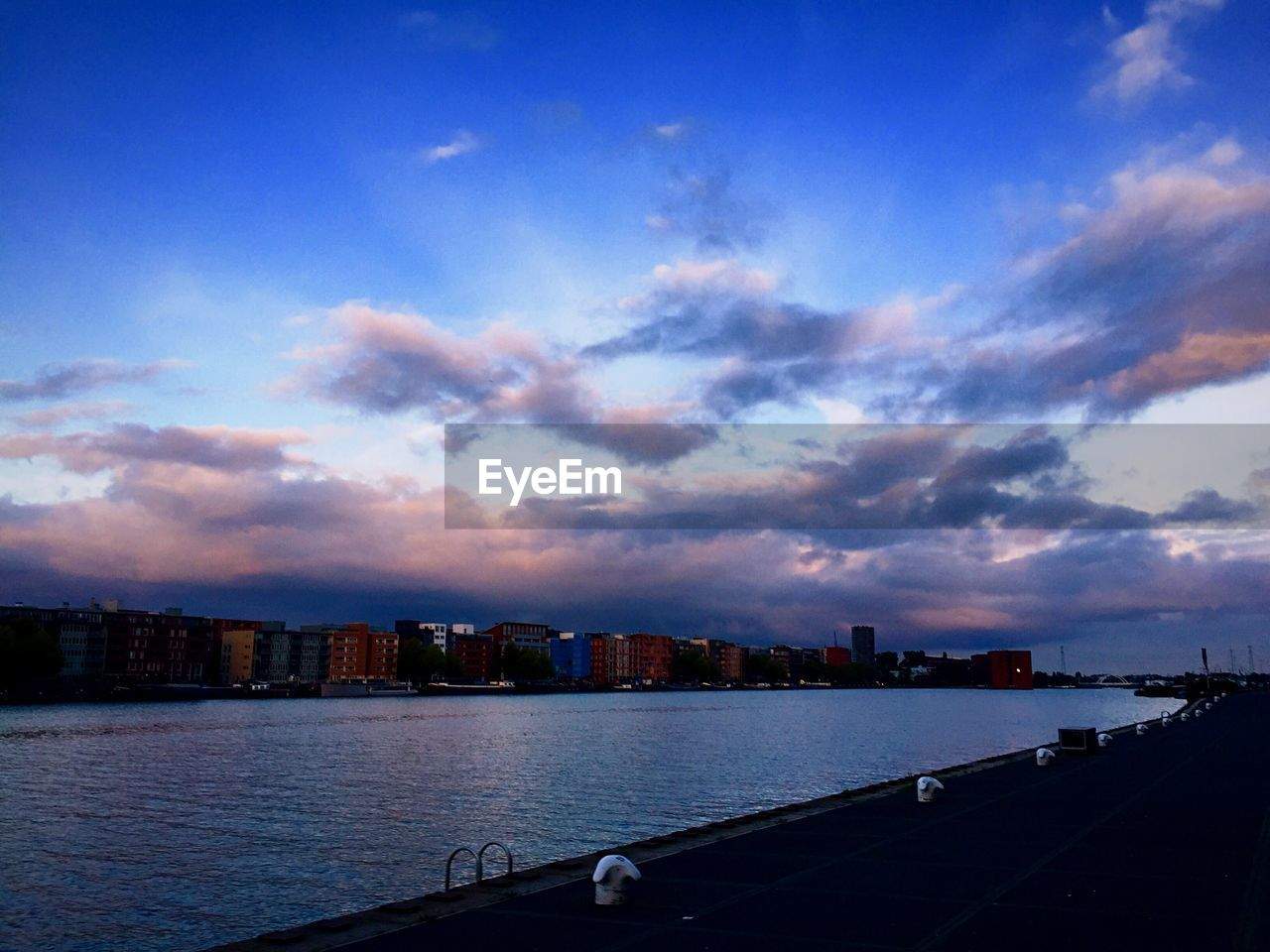 sky, cloud - sky, architecture, built structure, building exterior, water, city, river, outdoors, no people, cityscape, travel destinations, nautical vessel, sunset, nature, skyscraper, beauty in nature, day