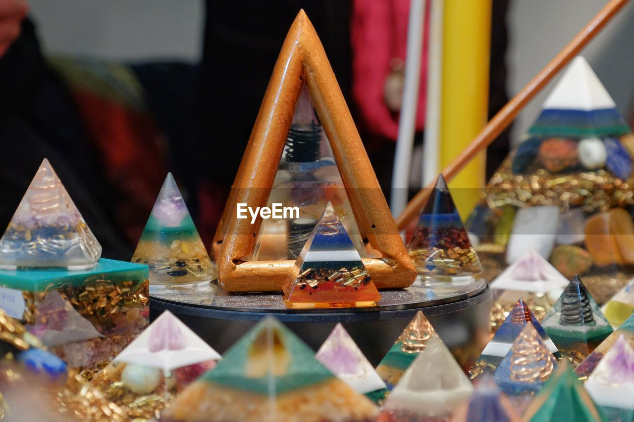 Close-up of multi colored pyramid shaped decoration for sale