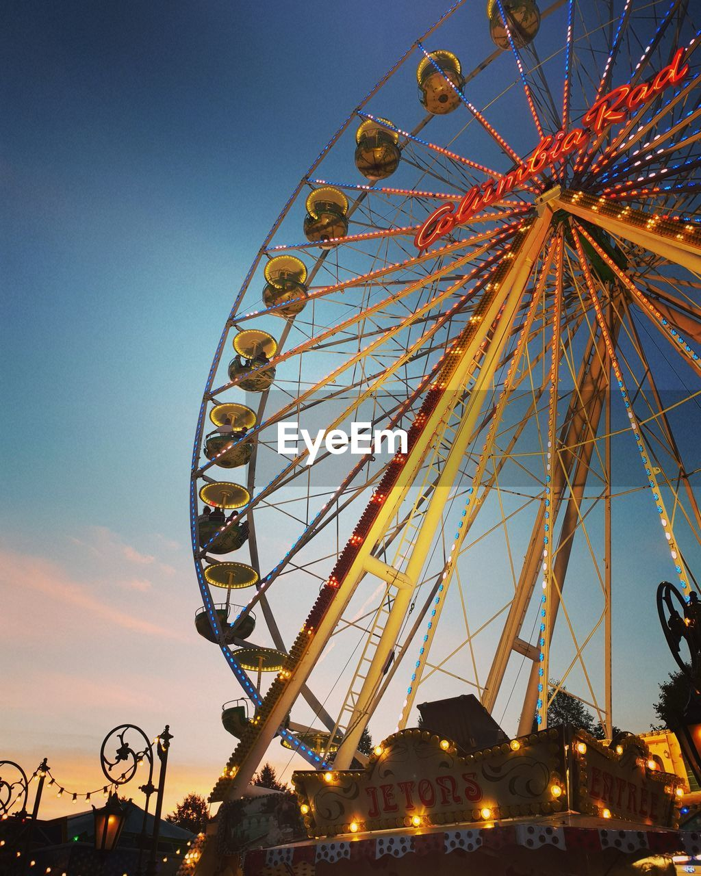 amusement park, amusement park ride, arts culture and entertainment, sky, ferris wheel, low angle view, leisure activity, fairground, no people, nature, large, geometric shape, architecture, shape, built structure, circle, carnival, outdoors, clear sky, blue, carnival - celebration event