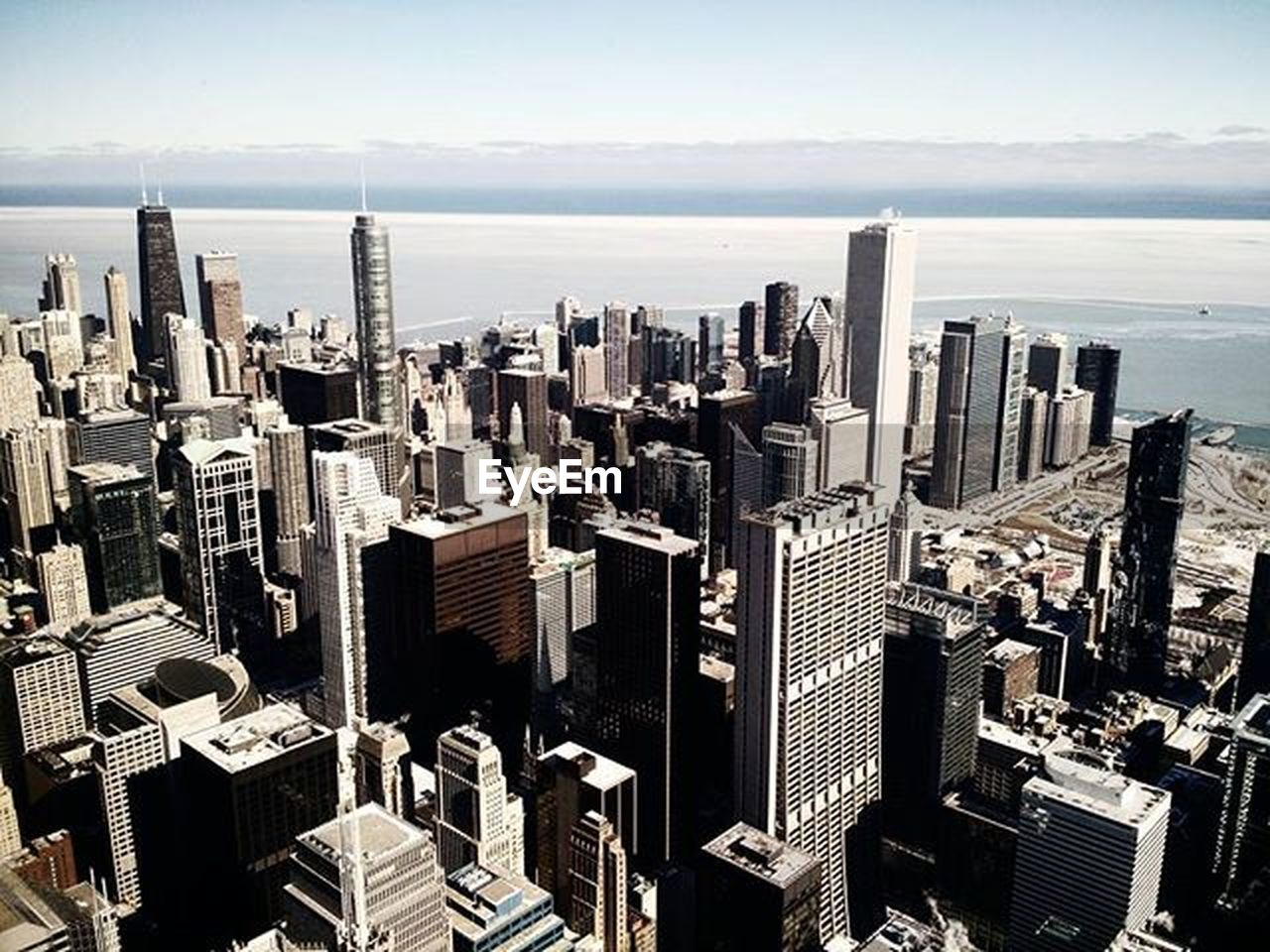skyscraper, cityscape, architecture, urban skyline, city, building exterior, tower, travel destinations, high angle view, crowded, downtown district, city life, built structure, modern, day, growth, sky, outdoors, people