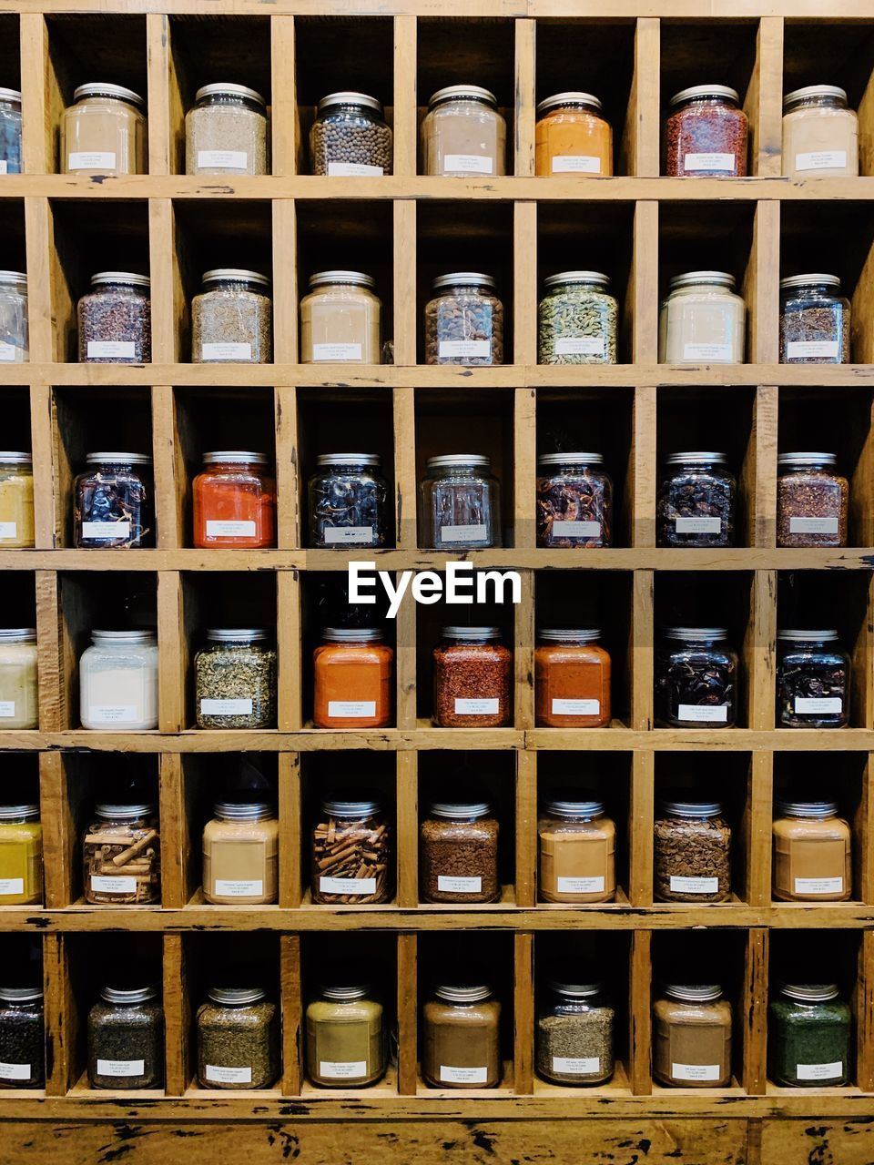 Full frame shot of spices in jar on display in shelves at store