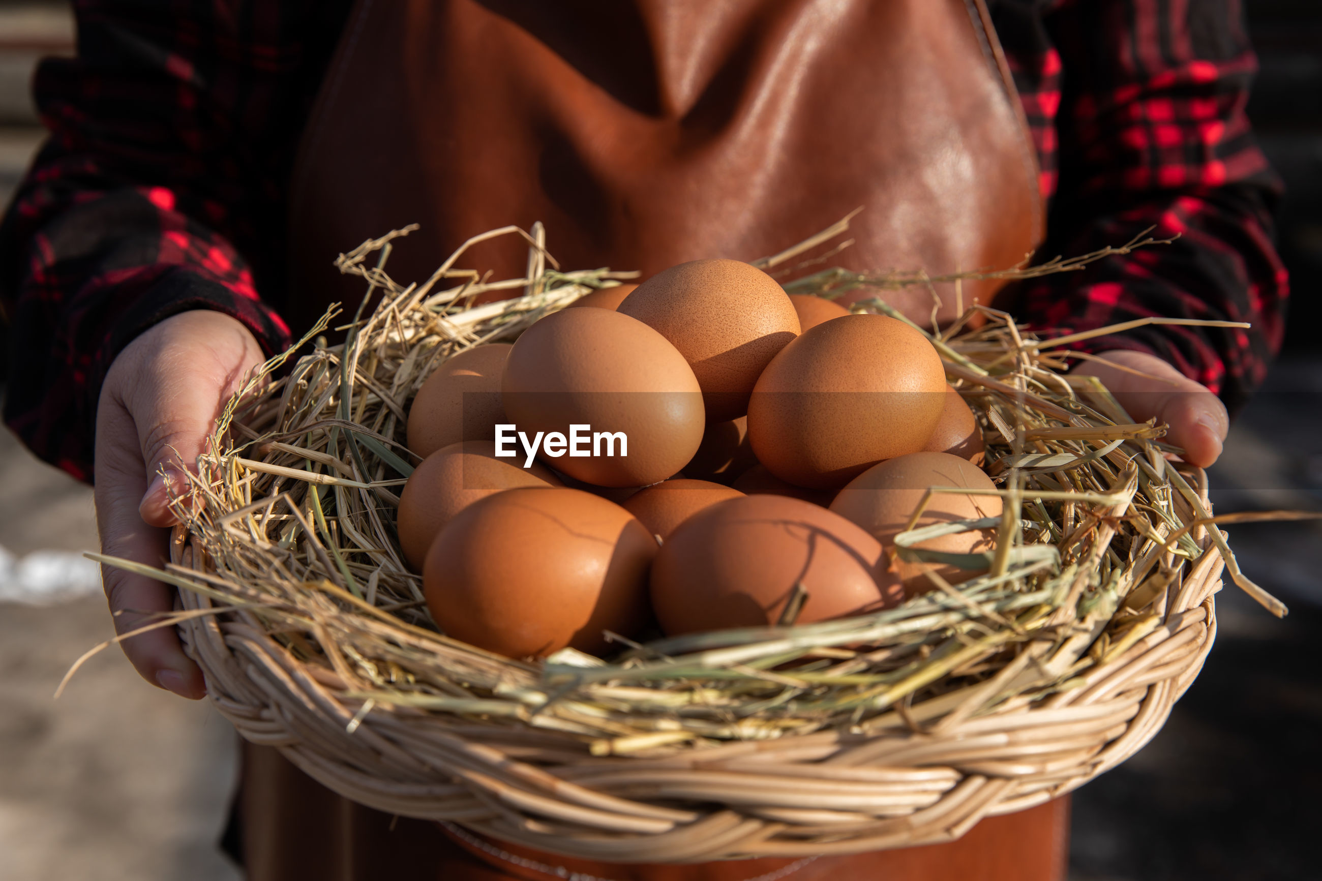 CLOSE-UP OF EGGS IN WICKER BASKET