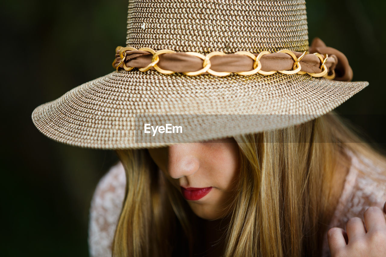 Close-up of woman wearing hat