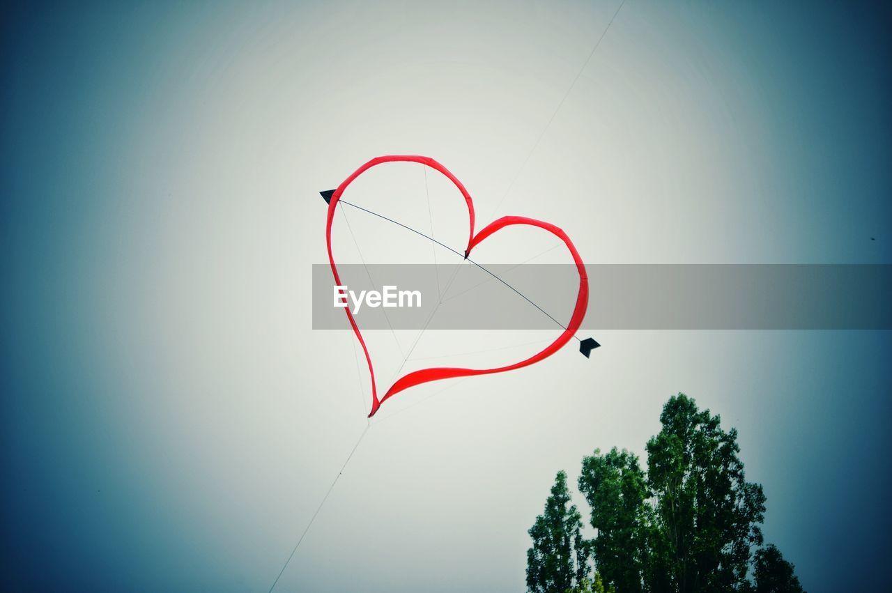 Heart Shape Kite Flying In Mid Air