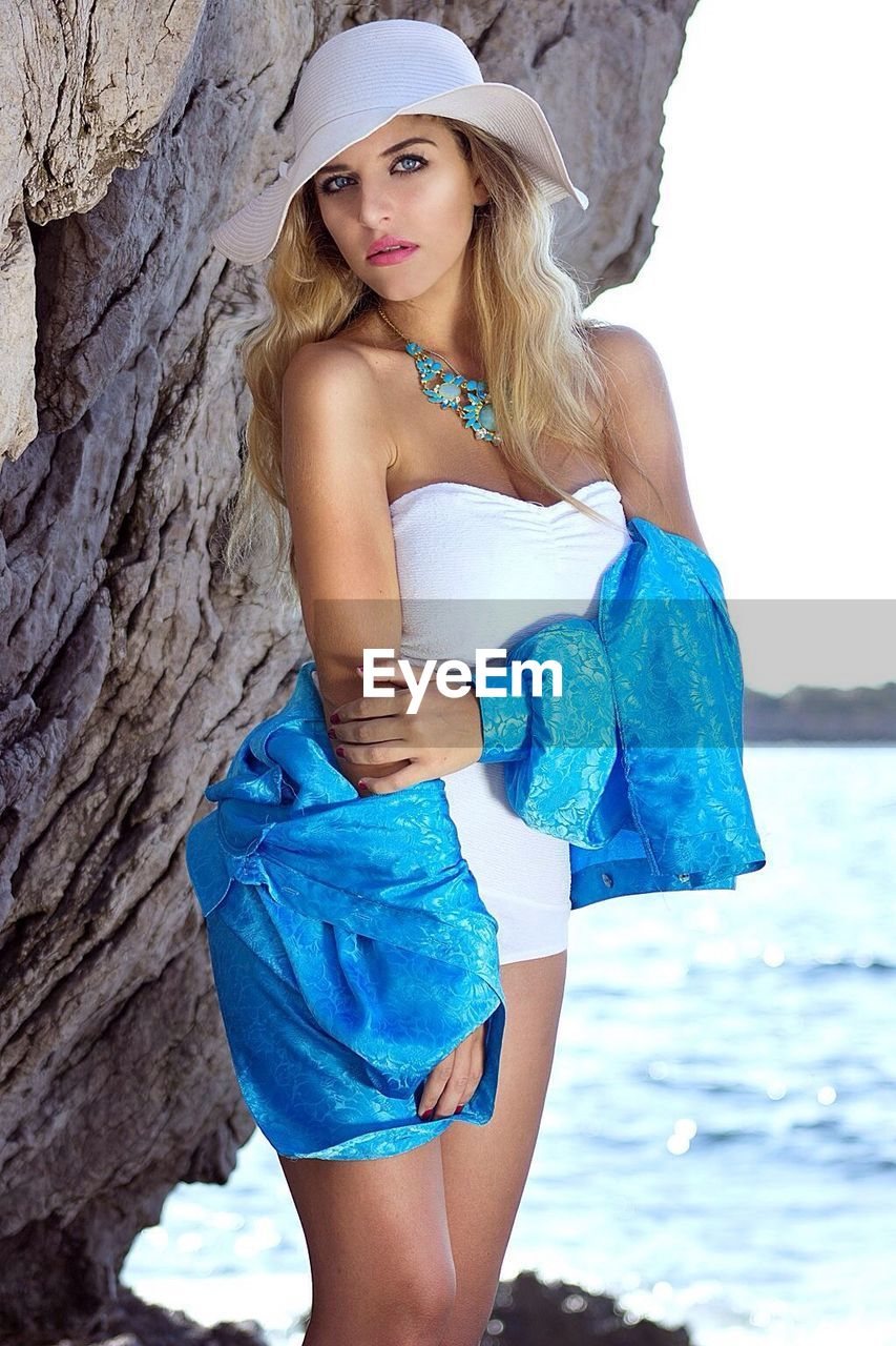 beautiful woman, young adult, young women, one person, beauty, portrait, looking at camera, real people, fashion, fashion model, beautiful people, standing, leisure activity, summer, lifestyles, women, beauty in nature, outdoors, blond hair, sea, nature, day, water, one young woman only, adult, people, adults only