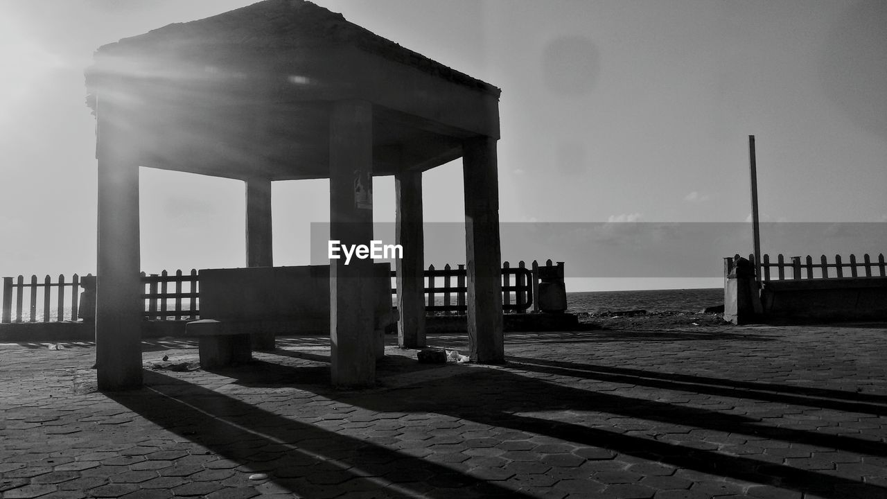 sky, beach, sea, outdoors, architectural column, built structure, pier, architecture, day, water, sand, cloud - sky, nature, horizon over water, no people, underneath