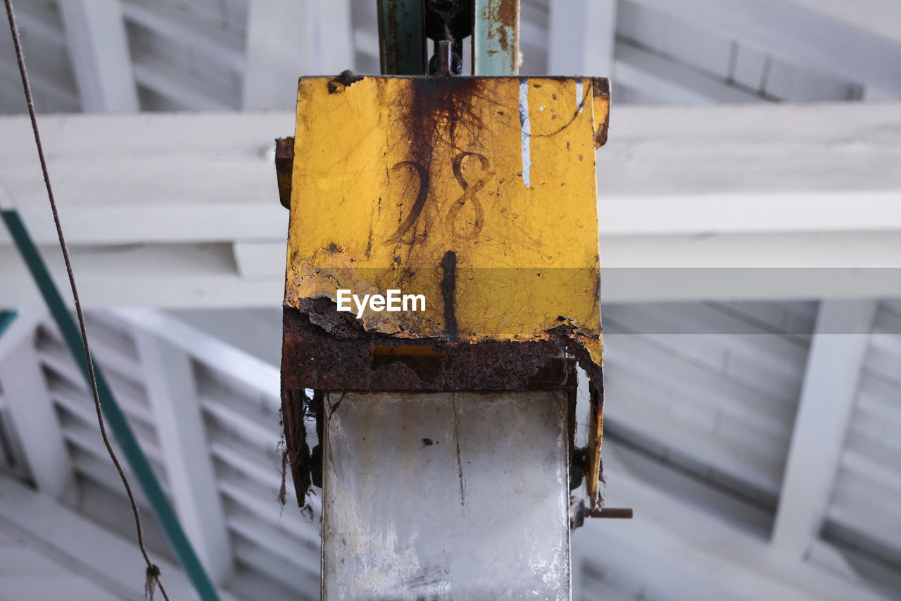 metal, yellow, rusty, no people, focus on foreground, close-up, day, outdoors, weathered, built structure, old, wall - building feature, security, protection, architecture, white color, decline, shape, safety