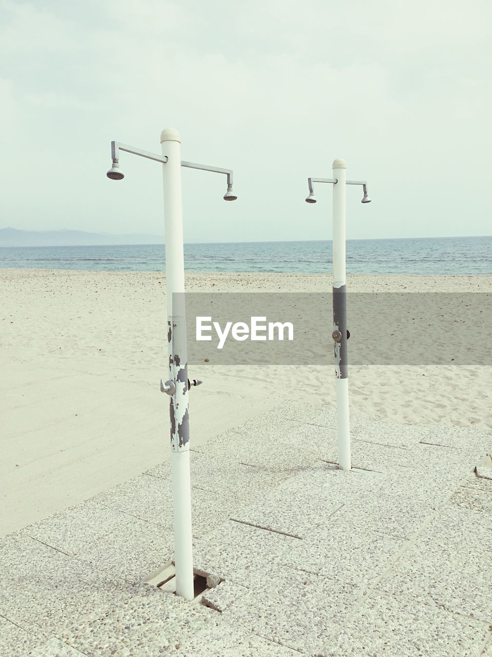 water, sea, beach, day, horizon over water, nature, safety, sky, scenics, beauty in nature, no people, sand, outdoors, tranquility, coin-operated binoculars, close-up