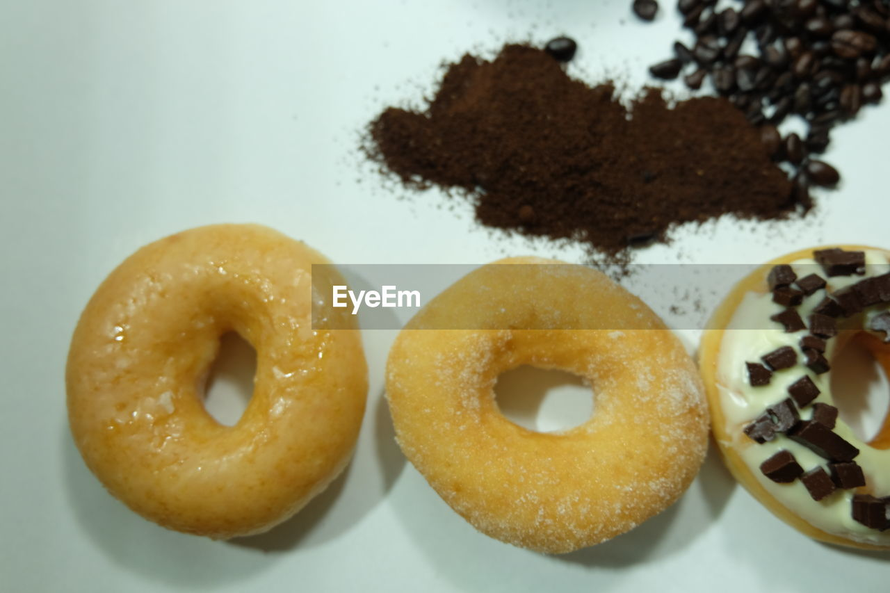food and drink, food, sweet food, indulgence, still life, ready-to-eat, freshness, indoors, temptation, unhealthy eating, baked, dessert, close-up, sweet, no people, donut, snack, focus on foreground, high angle view, brown, powdered sugar, breakfast, onion ring