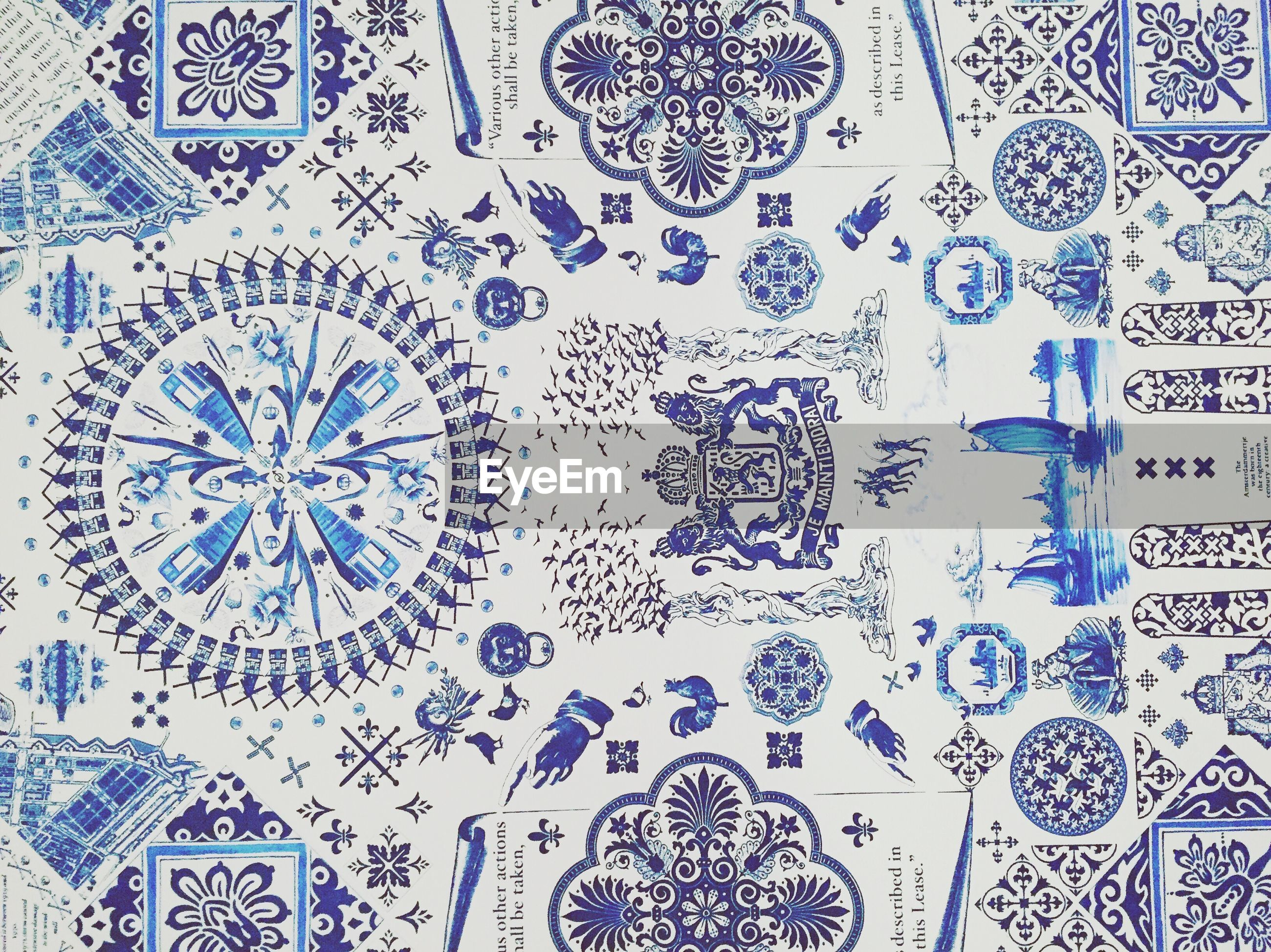 indoors, pattern, design, ceiling, full frame, backgrounds, art and craft, creativity, art, wall - building feature, floral pattern, geometric shape, circle, flooring, built structure, ornate, architecture, tile, wall, tiled floor