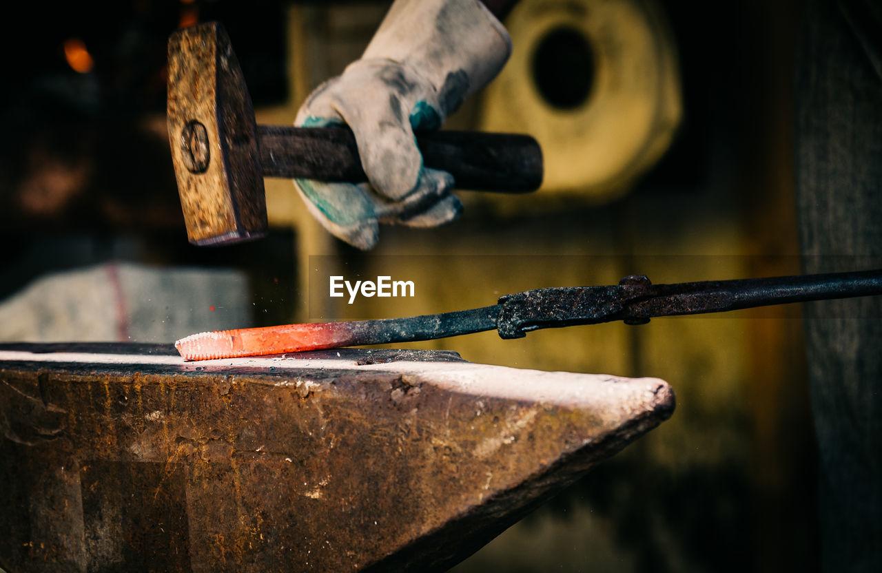 Close-Up Of Blacksmith's Hands