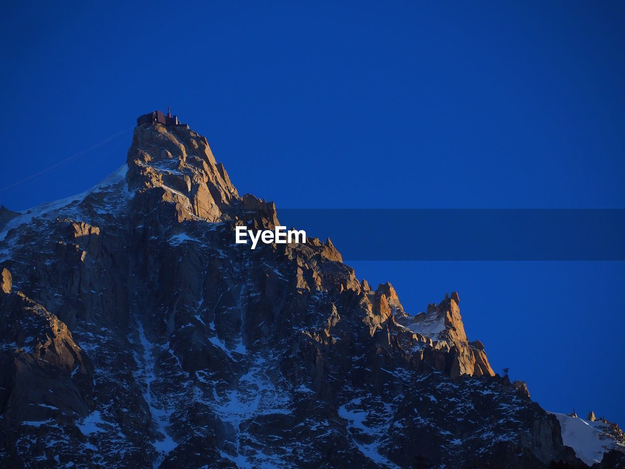 VIEW OF MOUNTAIN AGAINST BLUE SKY