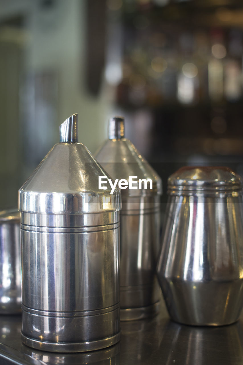 indoors, metal, close-up, focus on foreground, food and drink, table, container, still life, no people, steel, kitchen, household equipment, silver colored, shiny, restaurant, food, domestic kitchen, domestic room, alloy, kitchen utensil, chrome, crockery