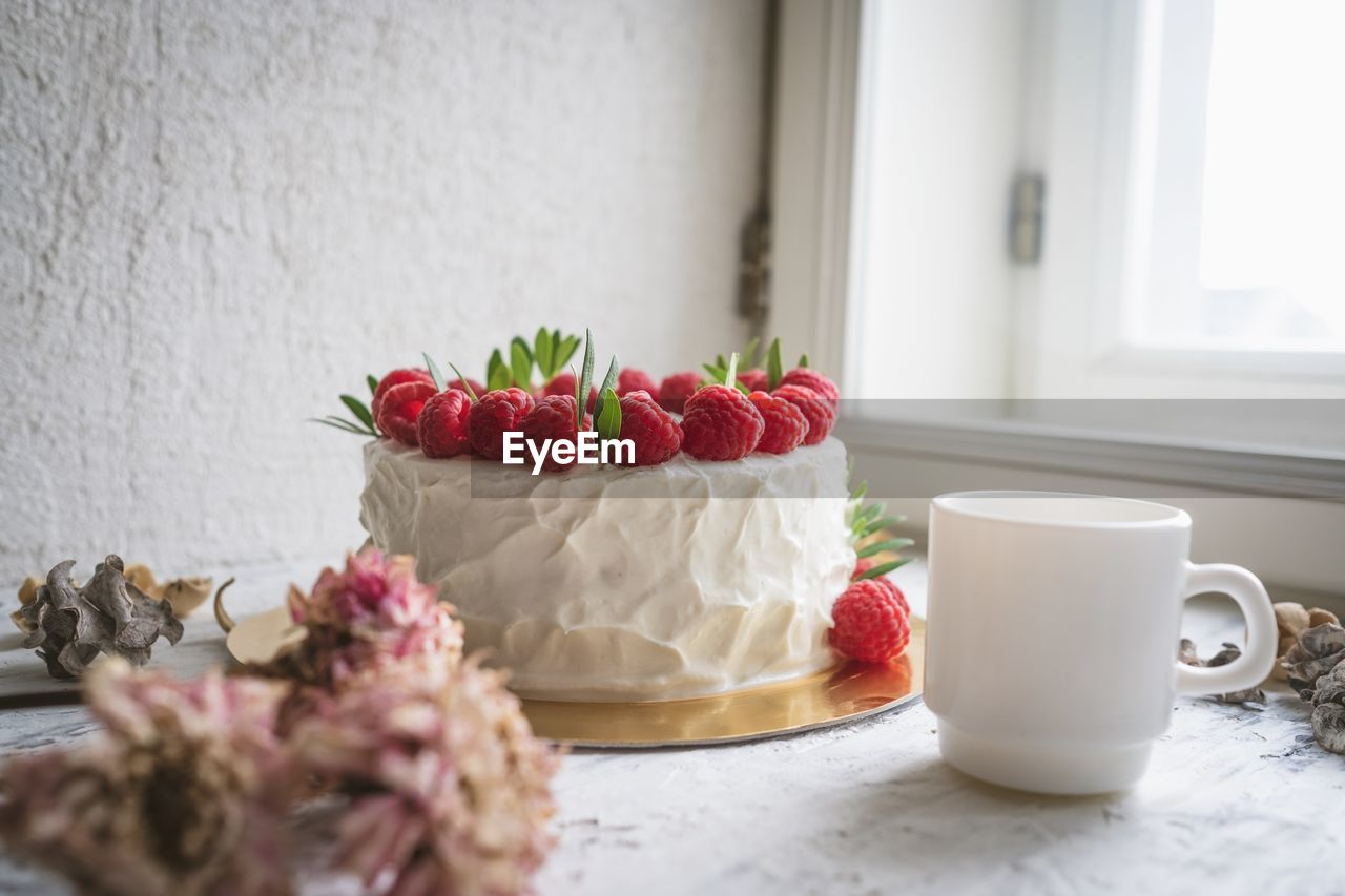 food and drink, freshness, food, indoors, sweet food, still life, cup, berry fruit, fruit, sweet, table, indulgence, cake, no people, dessert, temptation, close-up, flowering plant, plant, healthy eating, crockery, breakfast