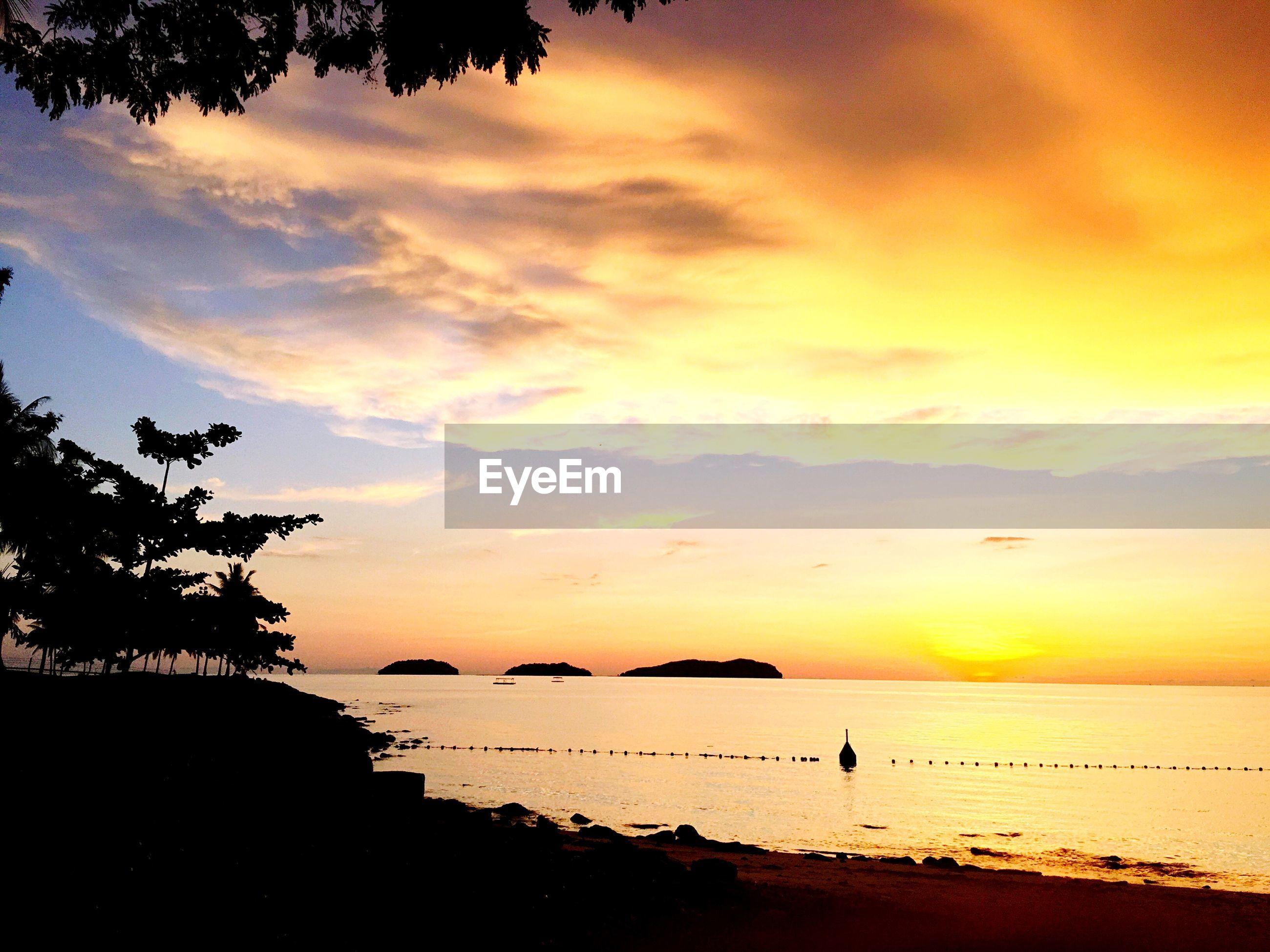 Moody sunset over calm sea