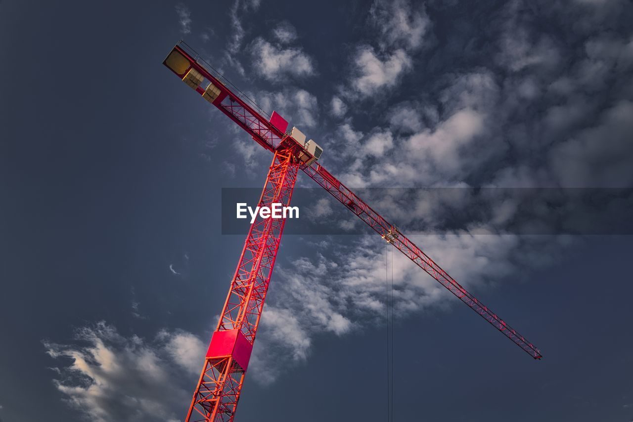 low angle view, cloud - sky, sky, crane - construction machinery, construction industry, industry, machinery, development, nature, construction site, tall - high, no people, red, day, outdoors, construction machinery, metal, incomplete, smoke - physical structure, construction equipment, industrial equipment