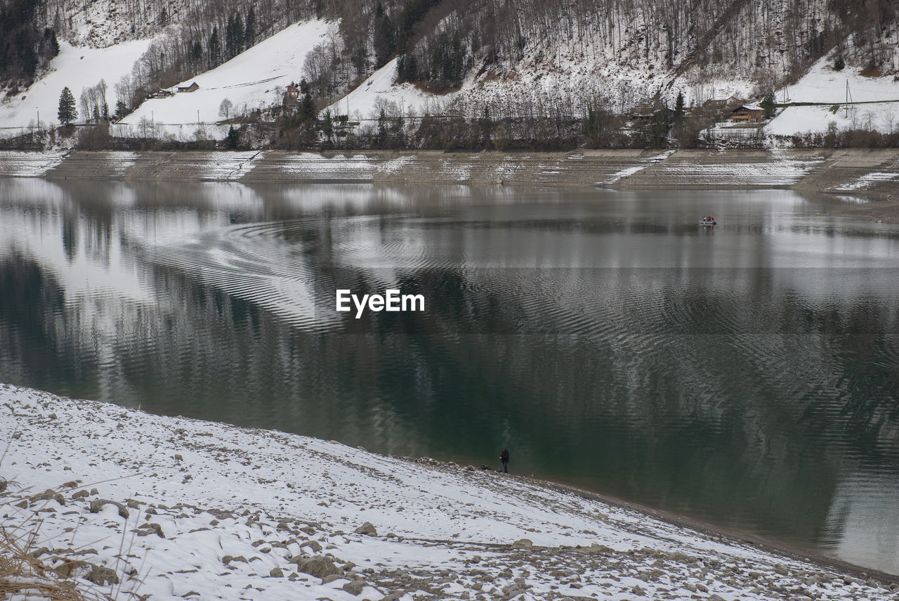 water, snow, winter, cold temperature, beauty in nature, reflection, lake, scenics - nature, tranquility, tranquil scene, nature, tree, mountain, day, non-urban scene, plant, outdoors, frozen, no people, snowcapped mountain