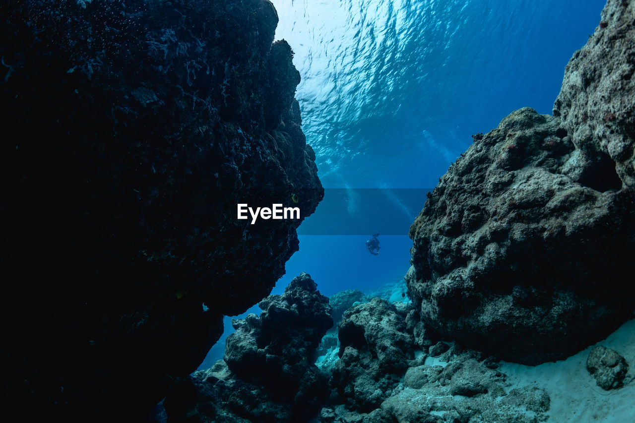 View of rock formation in sea