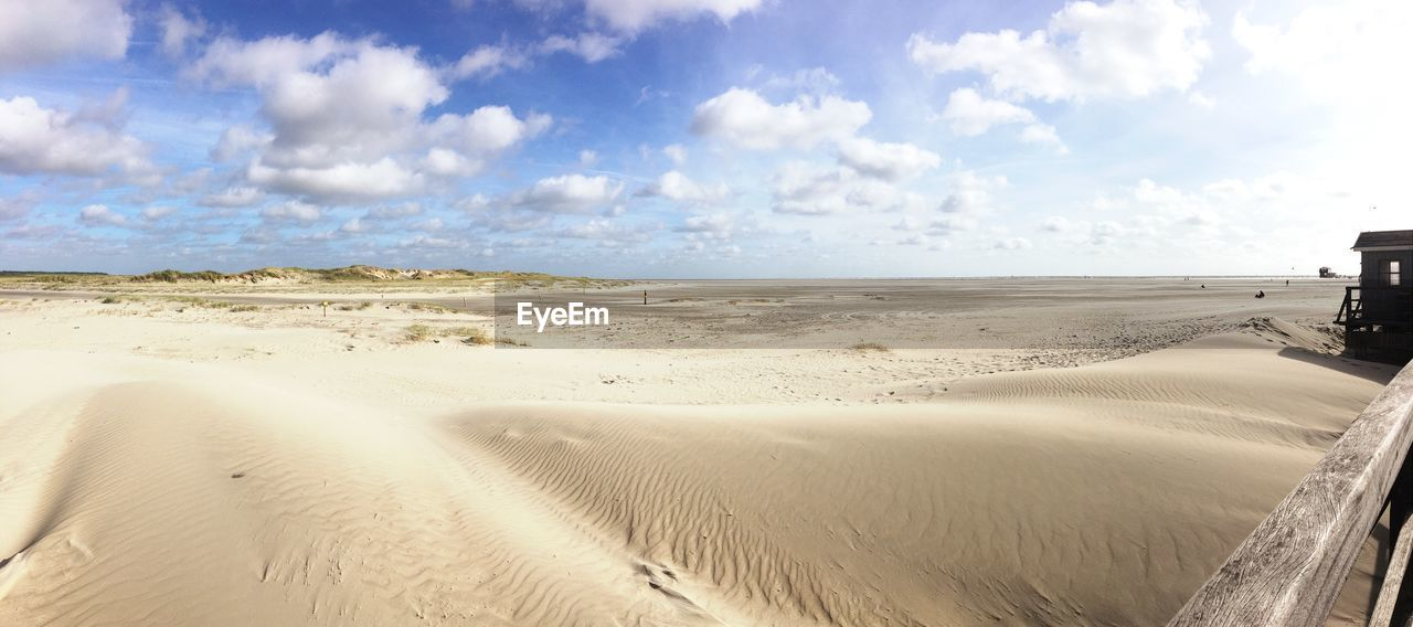 land, beach, sky, sand, cloud - sky, scenics - nature, beauty in nature, sea, tranquility, tranquil scene, water, horizon, day, sand dune, nature, landscape, non-urban scene, horizon over water, environment, no people, outdoors, climate, marram grass, arid climate