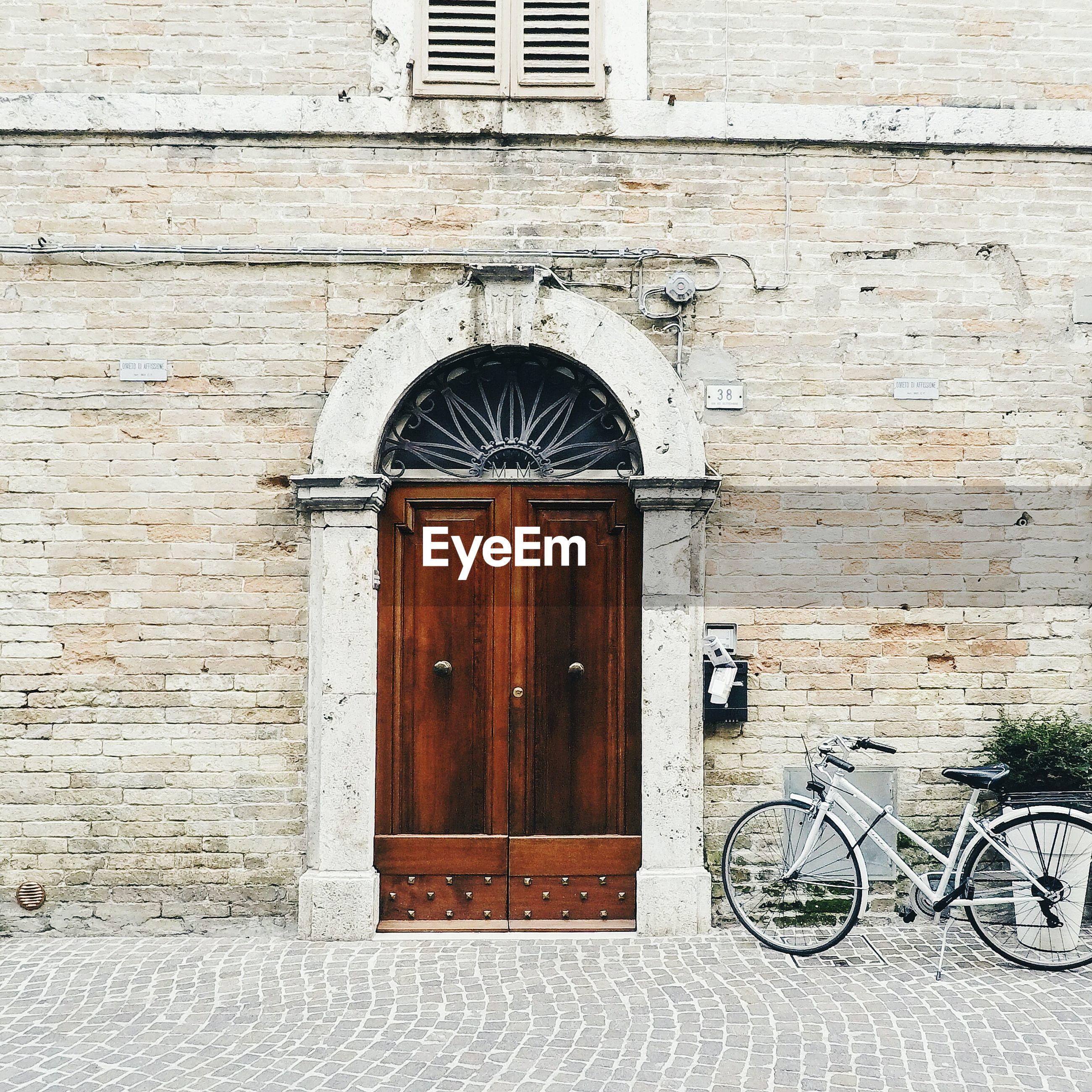 CLOSED DOOR OF WEATHERED BUILDING