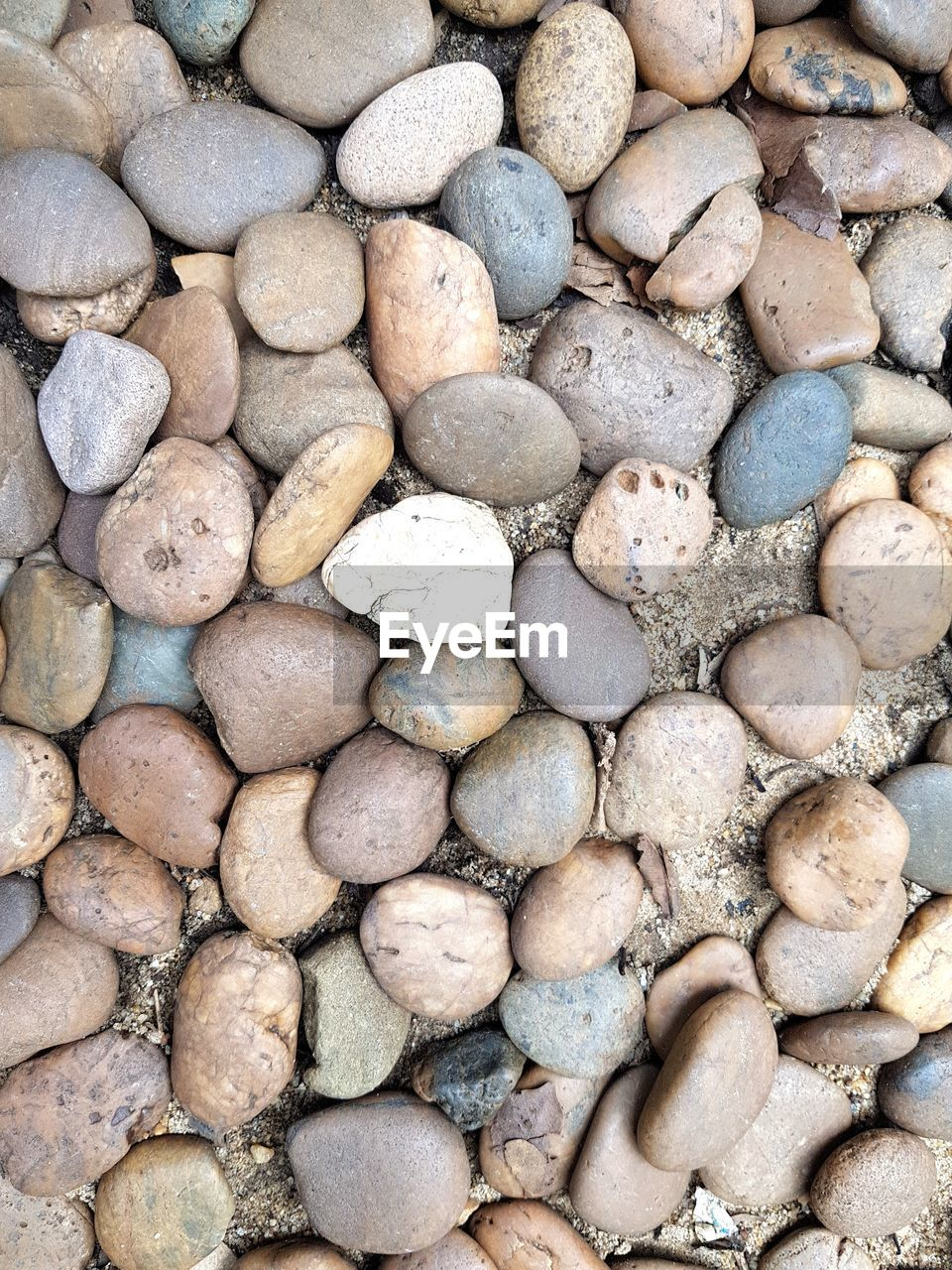 solid, backgrounds, full frame, rock, large group of objects, stone - object, stone, no people, pebble, abundance, nature, day, rock - object, pattern, land, high angle view, textured, beach, outdoors, rough