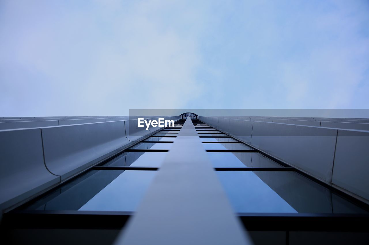 architecture, sky, built structure, diminishing perspective, low angle view, no people, day, nature, direction, the way forward, building exterior, outdoors, blue, directly below, metal, building, pattern, railing, tall - high, selective focus, office building exterior, skyscraper, long