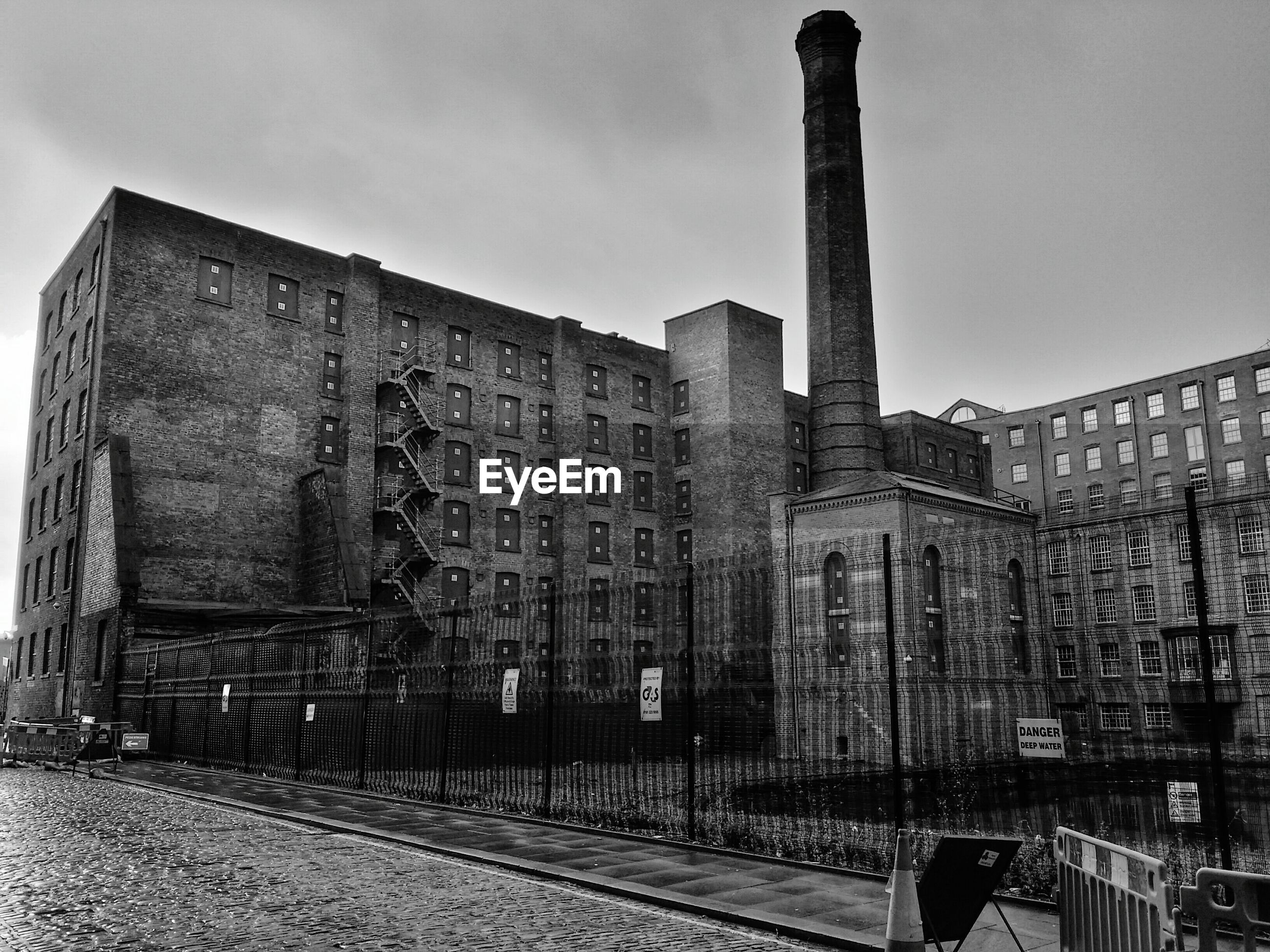 Factory building with smoke stack