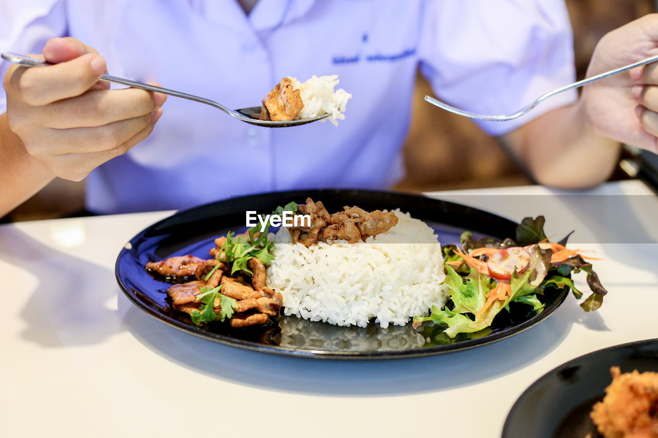 human hand, hand, food and drink, real people, freshness, ready-to-eat, holding, table, human body part, food, focus on foreground, plate, midsection, unrecognizable person, one person, wellbeing, close-up, eating utensil, kitchen utensil, healthy eating, meal