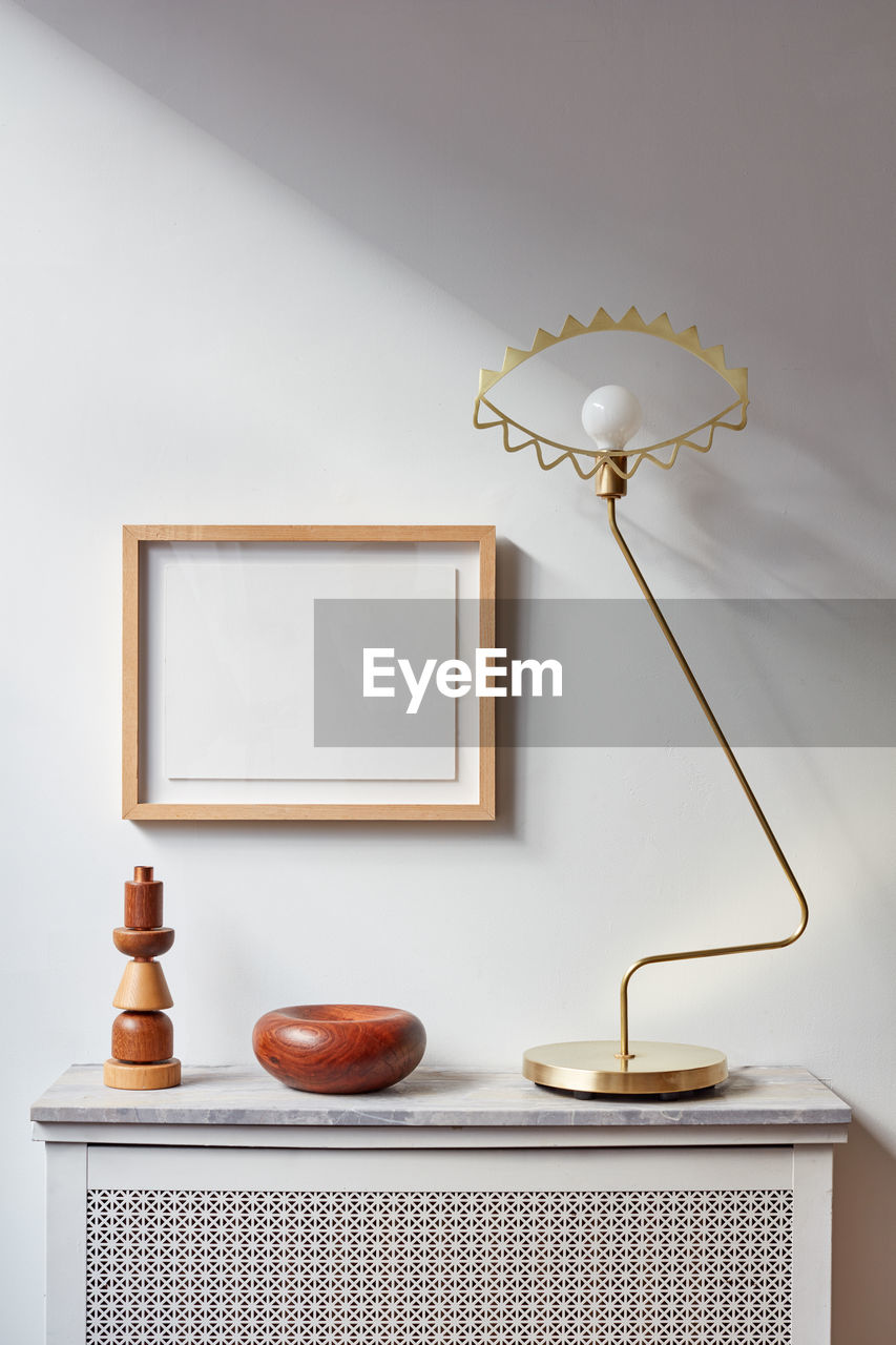 CLOSE-UP OF LAMP ON TABLE AT HOME
