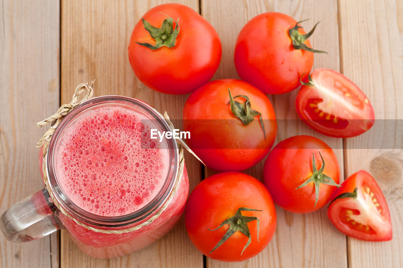 Close-up of tomatoes and juice on table