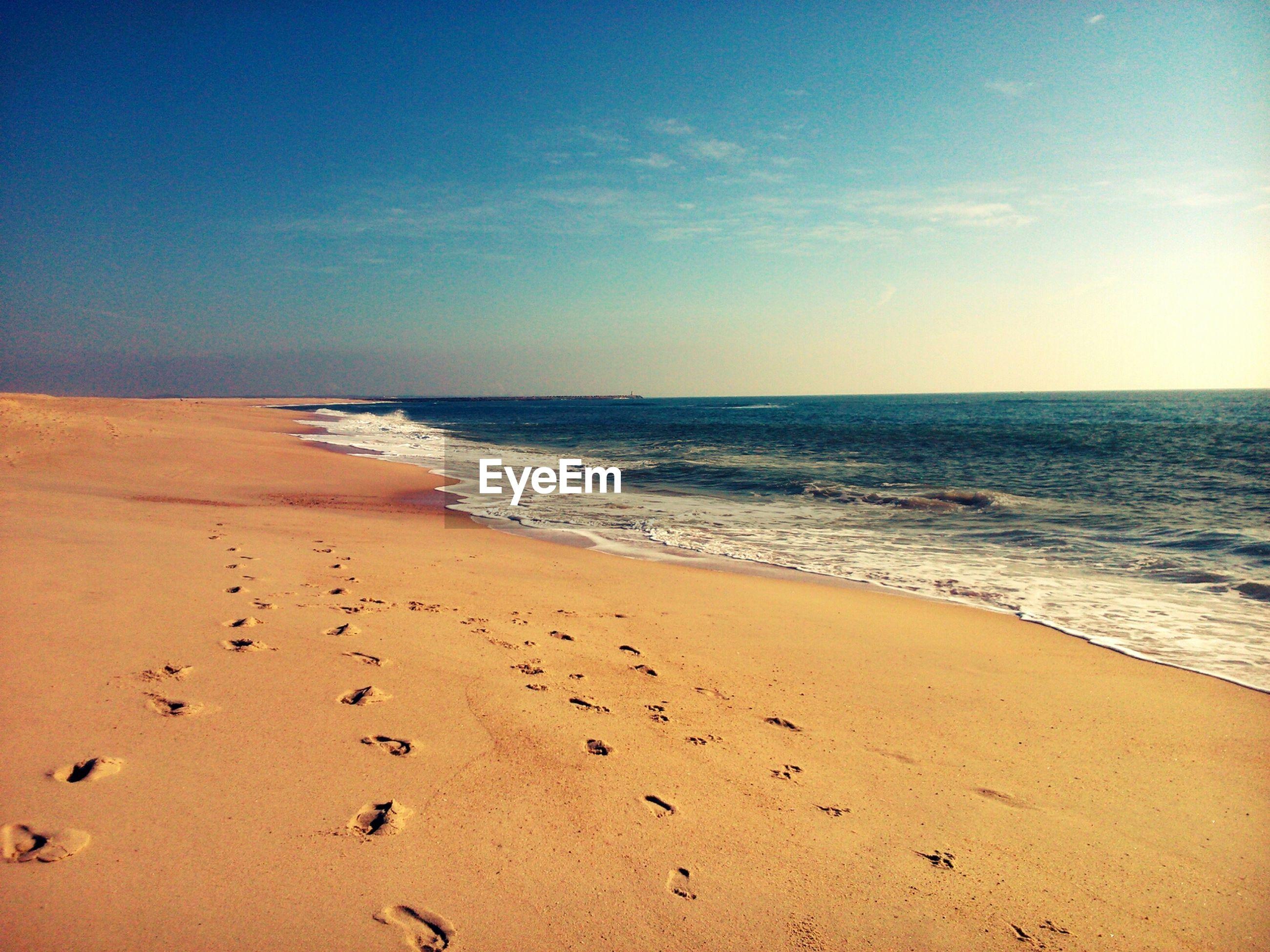 View Of Footprints On Beach