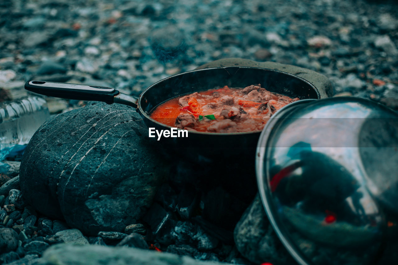 Close-Up Of Food Cooking In Pan On Camping Stove