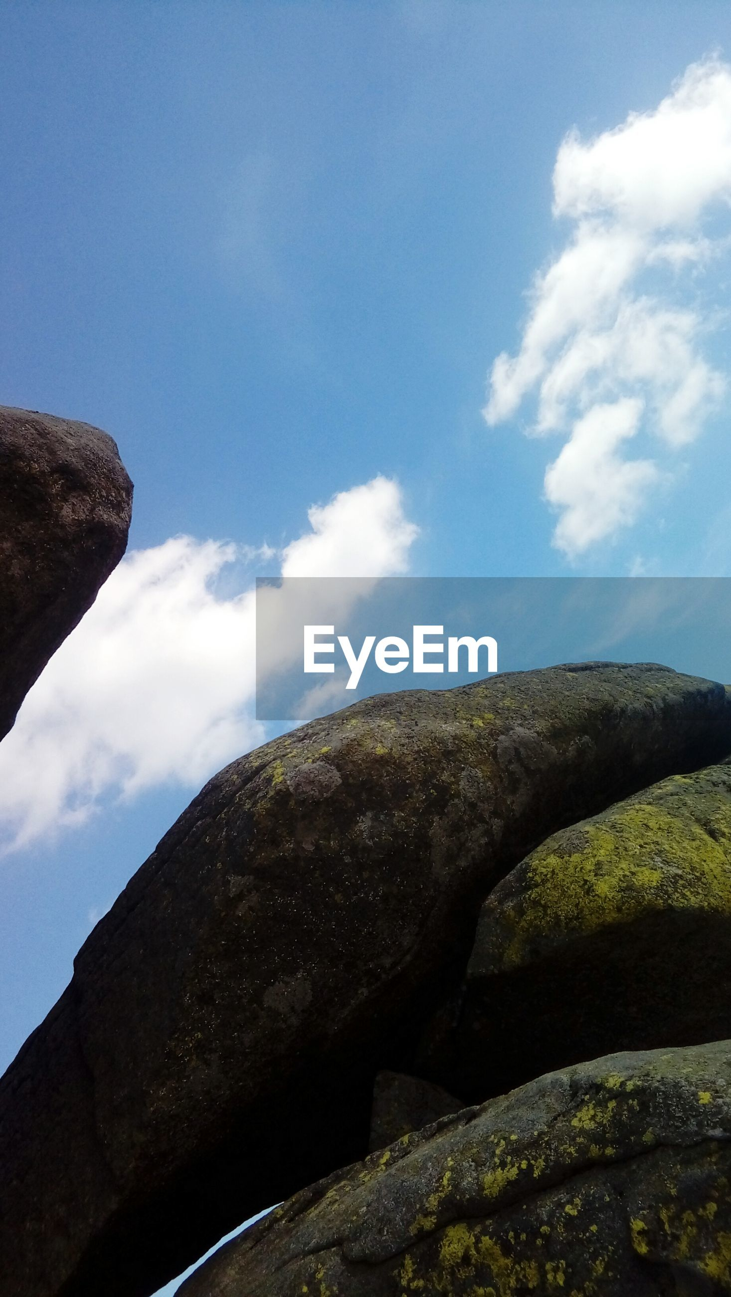 sky, low angle view, cloud - sky, rock - object, day, beauty in nature, outdoors, nature, tranquility, no people
