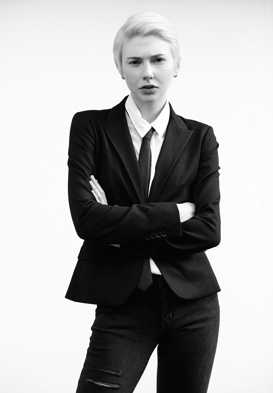 studio shot, portrait, white background, three quarter length, one person, looking at camera, young adult, well-dressed, confidence, suit, front view, attitude, young women, business, fashion, blond hair, beautiful woman, standing, real people, fashion model, day, adult, people