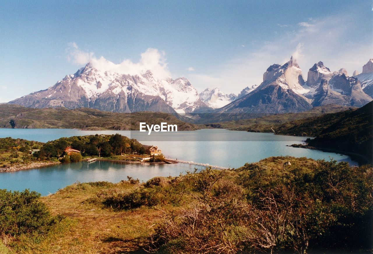 Scenic view of river by mountains at torres del paine national park